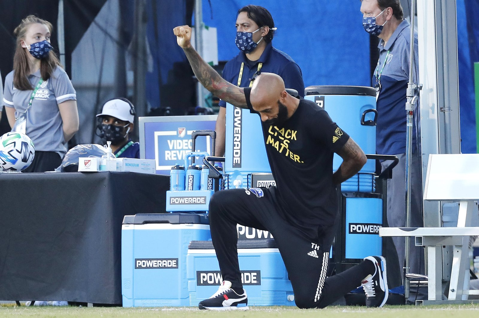 Montreal Impact head coach Thierry Henry takes a knee in support of the Black Lives Matter movement prior to the Group C football match between Montreal Impact and Toronto FC as part of the MLS Is Back Tournament at ESPN Wide World of Sports Complex in Reunion, Florida, July 16, 2020. (Getty Images)