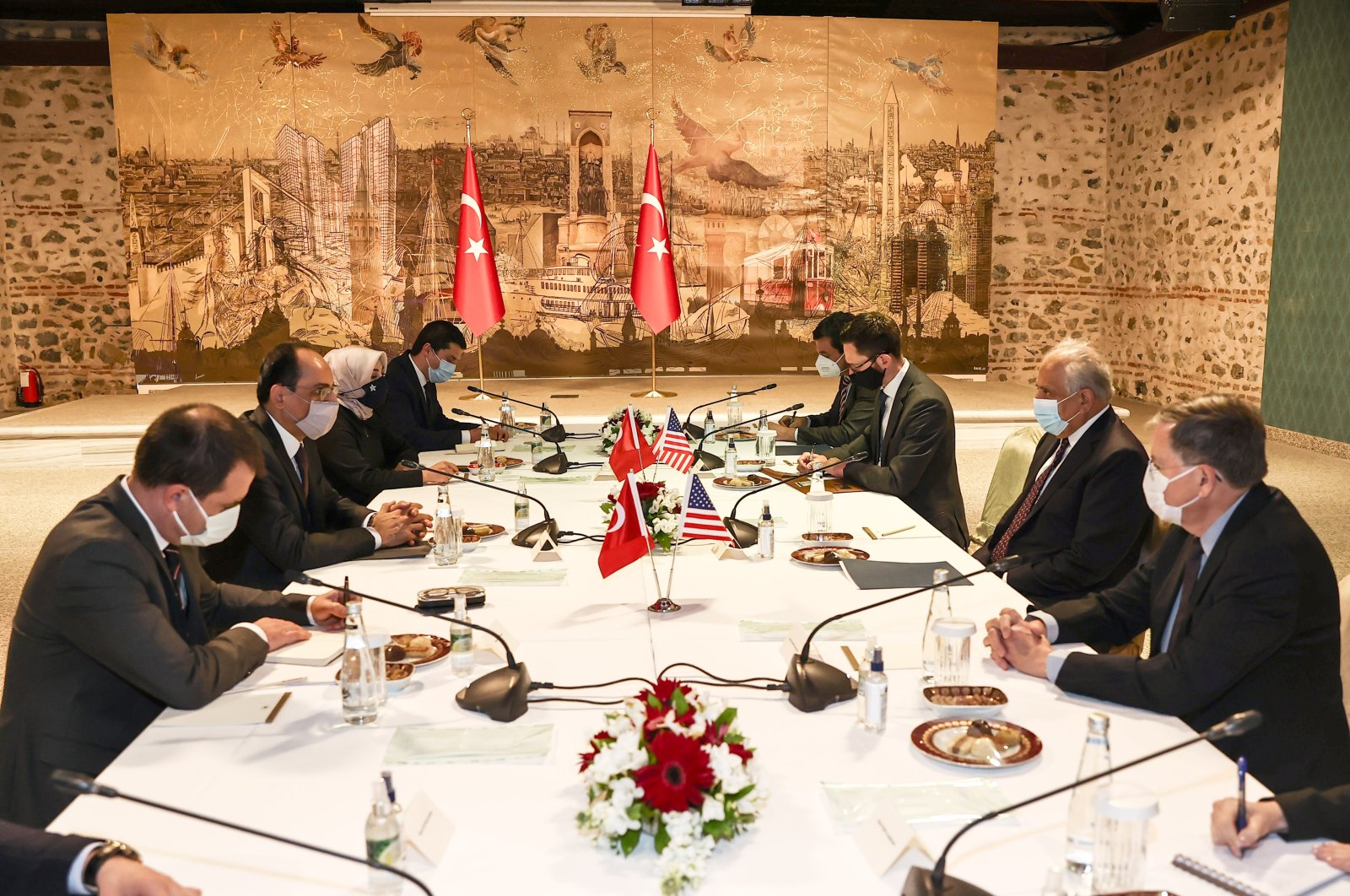 Turkey's Presidential Spokesperson Ibrahim Kalın (2nd L) and U.S. Special Representative for Afghanistan Zalmay Khalilzad (2nd R) sit at a table with their accompanying delegations in Istanbul, Turkey, March 27, 2021. (DHA Photo)