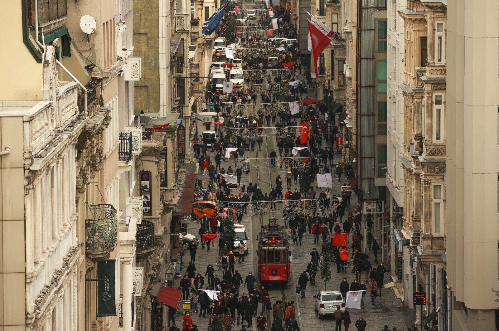 People walk on Istiklal street, the main shopping street of Istanbul, Turkey, March 25, 2021. (AP Photo)