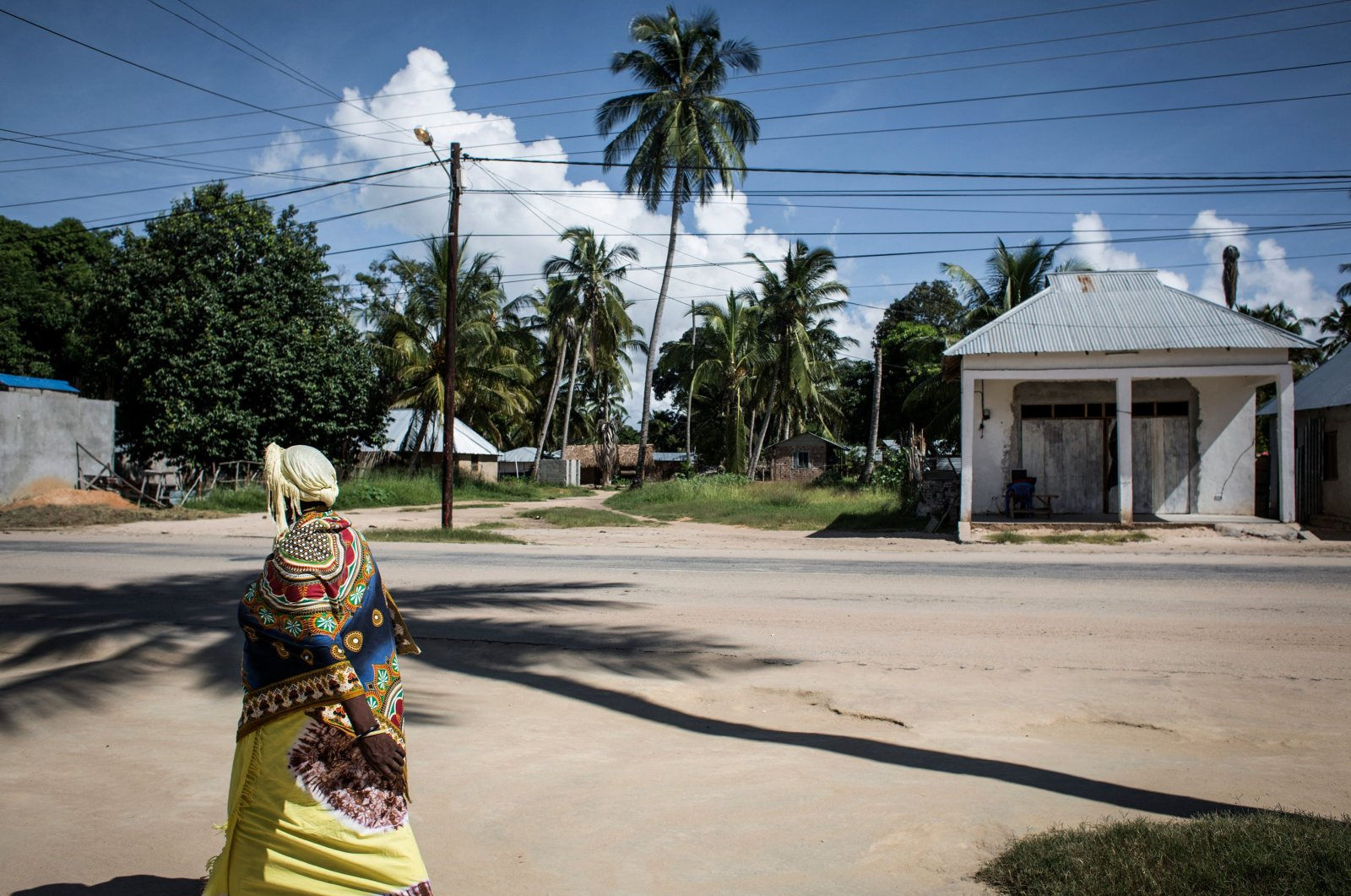 A Mozambican woman walks in Palma, a small, palm-fringed fishing town meant to become a symbol of Mozambique's glittering future, transformed by one of the world's largest liquefied natural gas projects Febr. 16, 2017. (AFP Photo)