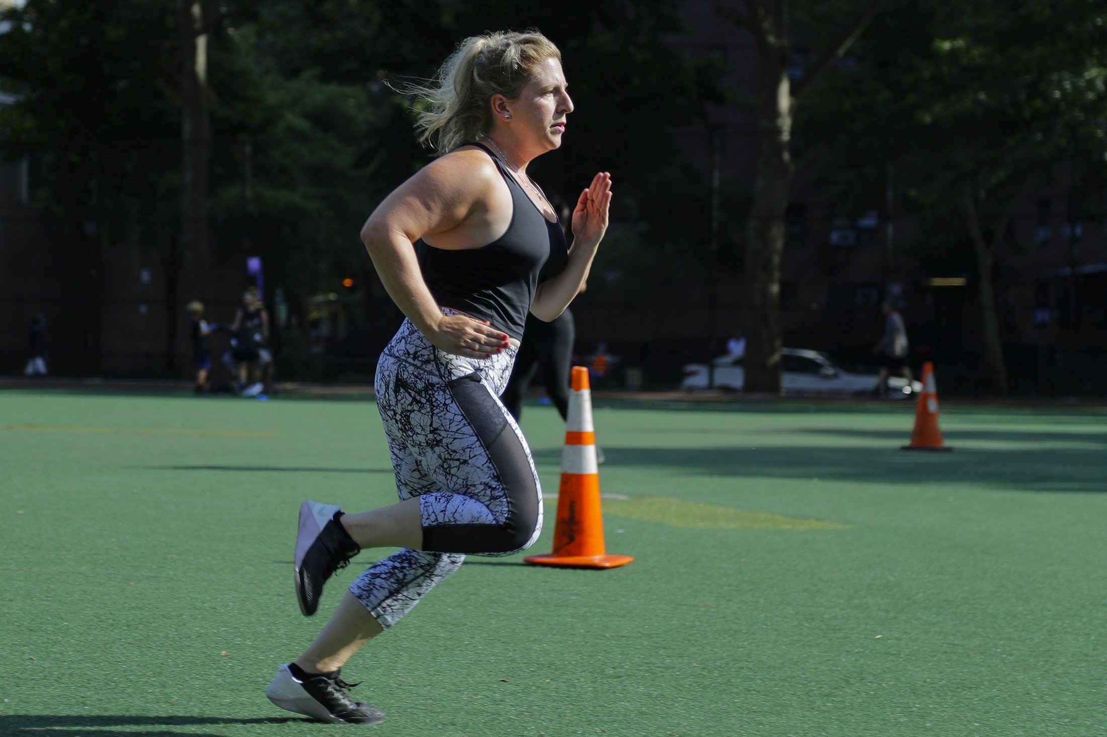 Lauren Wire works out during a fitness class Wednesday, July 15, 2020, in New York. Many Americans are changing clothing sizes depending on how they spent their time sheltering at home. (AP Photo)