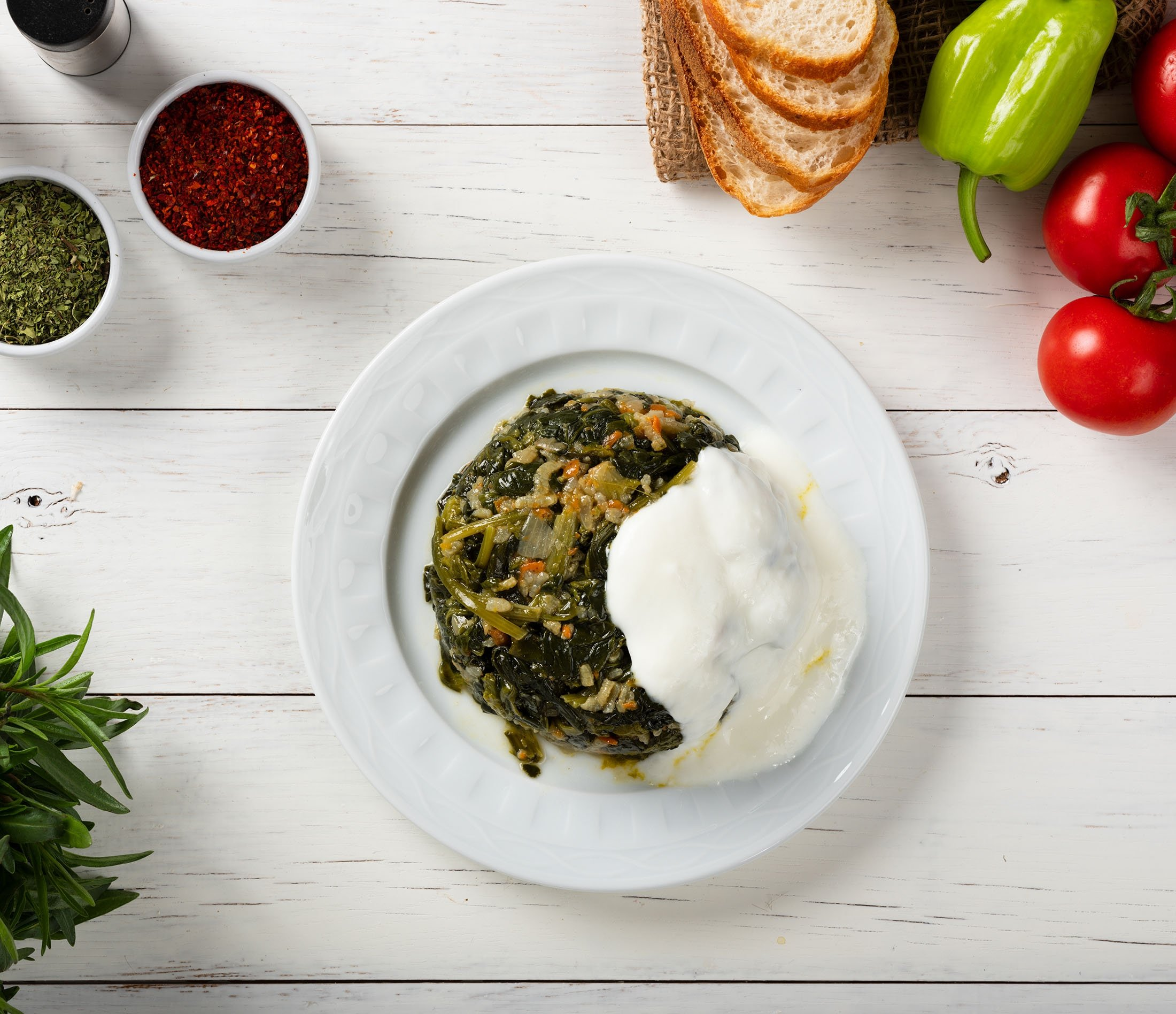A tomatoey spinach stew is almost always consumed with yoıugrt in Turkey. (Shutterstock Photo)