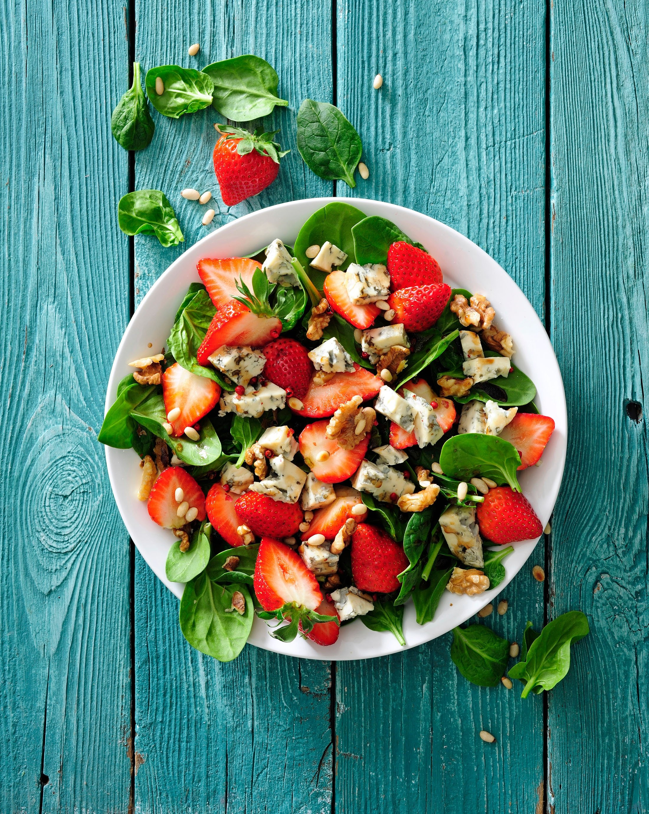 Add nuts and cheese to your spinach and strawberry salad for extra flavor. (Shutterstock Photo)