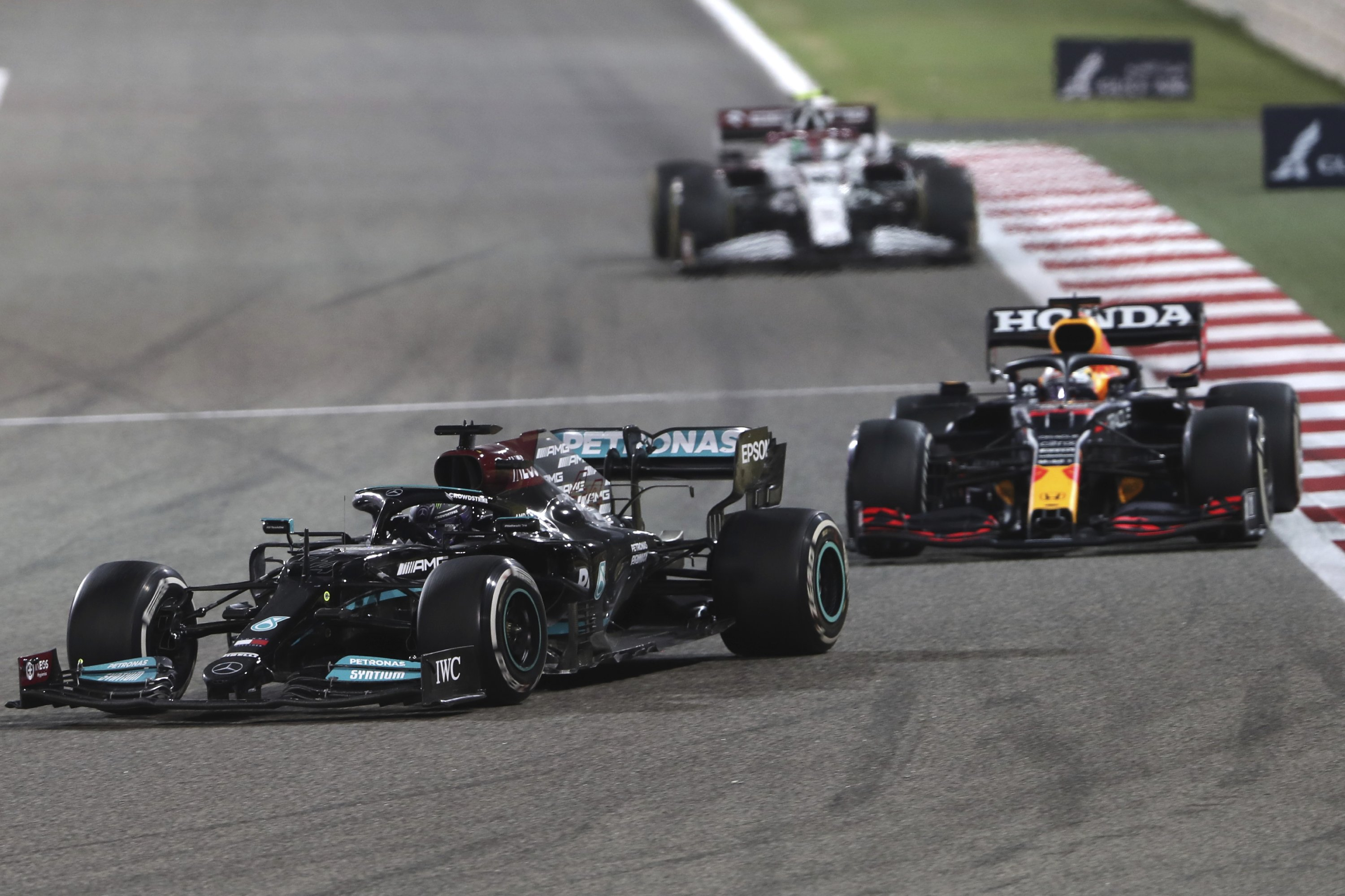 Mercedes driver Lewis Hamilton of Britain steers his car followed by Red Bull driver Max Verstappen of the Netherlands during the Bahrain Formula One Grand Prix at the Bahrain International Circuit in Sakhir, Bahrain, March 28, 2021. (AP Photo)