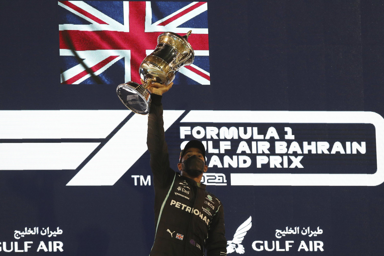 Mercedes driver Lewis Hamilton of Britain celebrates on the podium after winning the Bahrain Formula One Grand Prix at the Bahrain International Circuit in Sakhir, Bahrain, March 28, 2021. (AP Photo)
