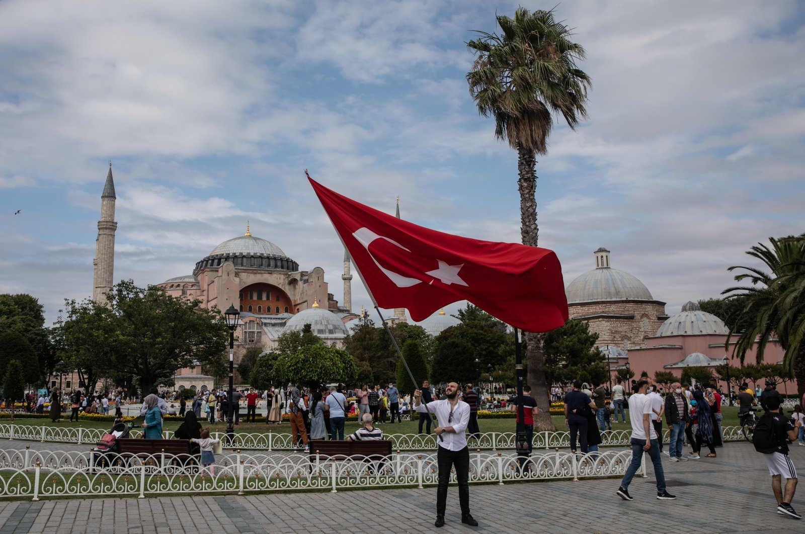 A man waves Turkey's national flag at Sultanahmet Square, on the fourth anniversary of the July 15, 2016 failed coup attempt, Istanbul, Turkey, July 15, 2020. (Photo by Getty Images)