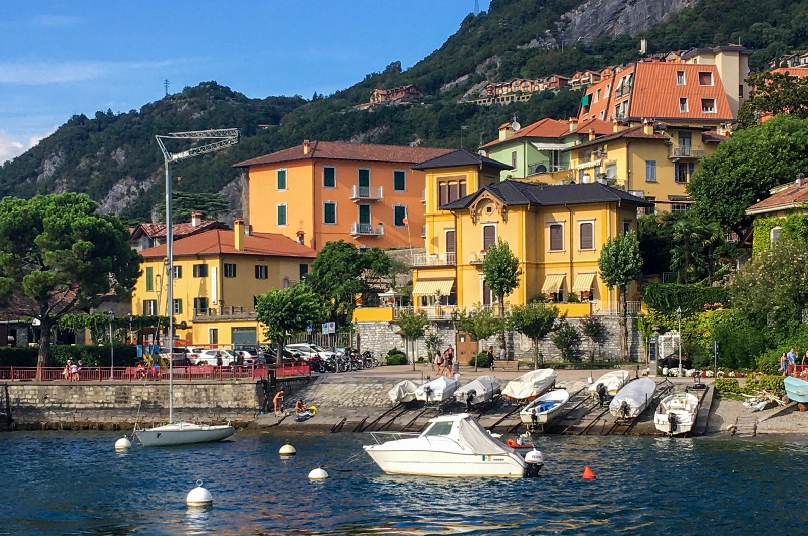 Boats and houses on Lake Como in the city of Varenna, Lombardy, Italy, Aug. 19, 2020. (AFP Photo)