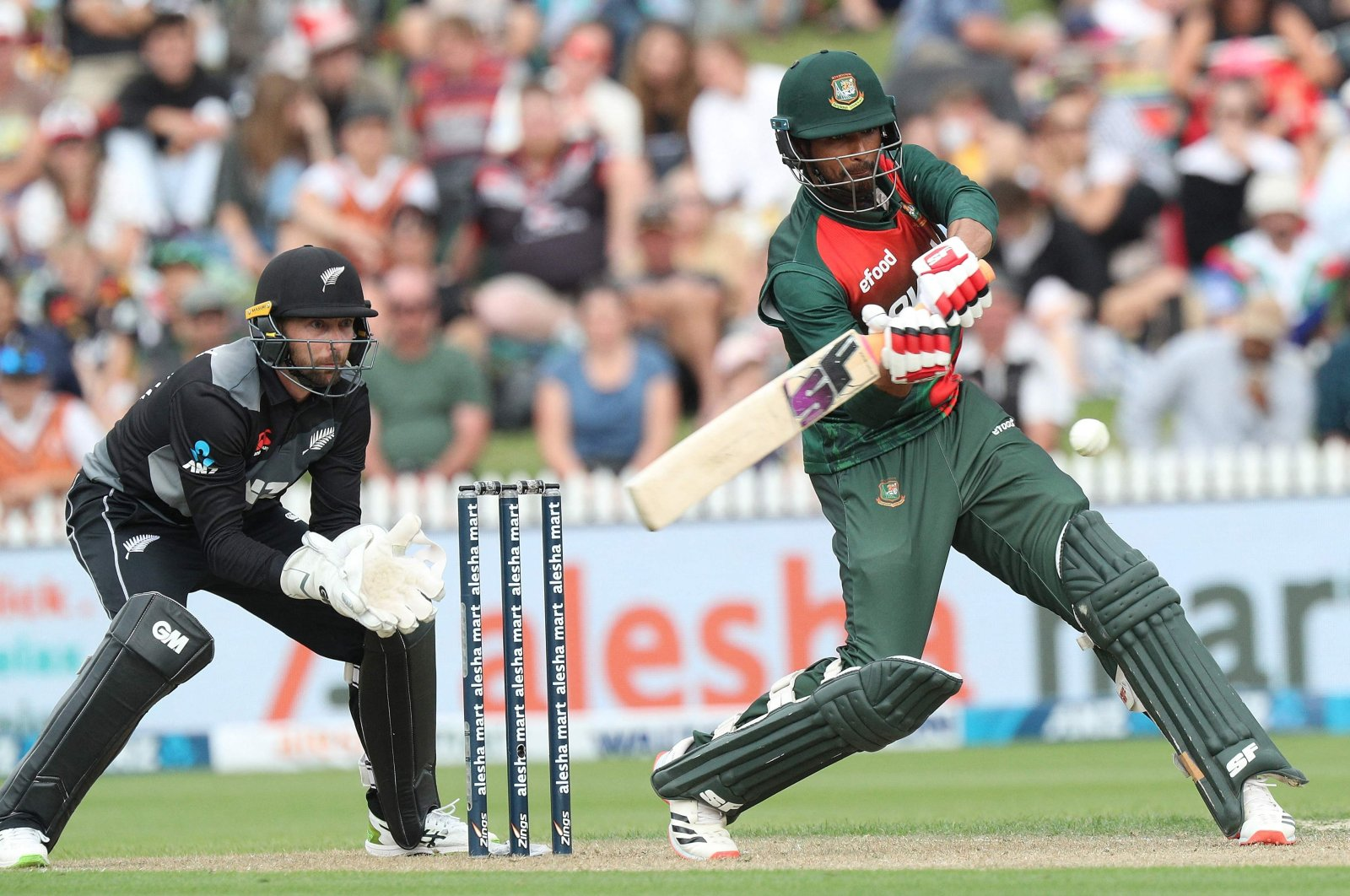 Bangladesh's Mahmudullah plays a shot in front of New Zealand's wicketkeeper Devon Conway during a T20 cricket match at Seddon Park, Hamilton, New Zealand, March 28, 2021. (AFP Photo)