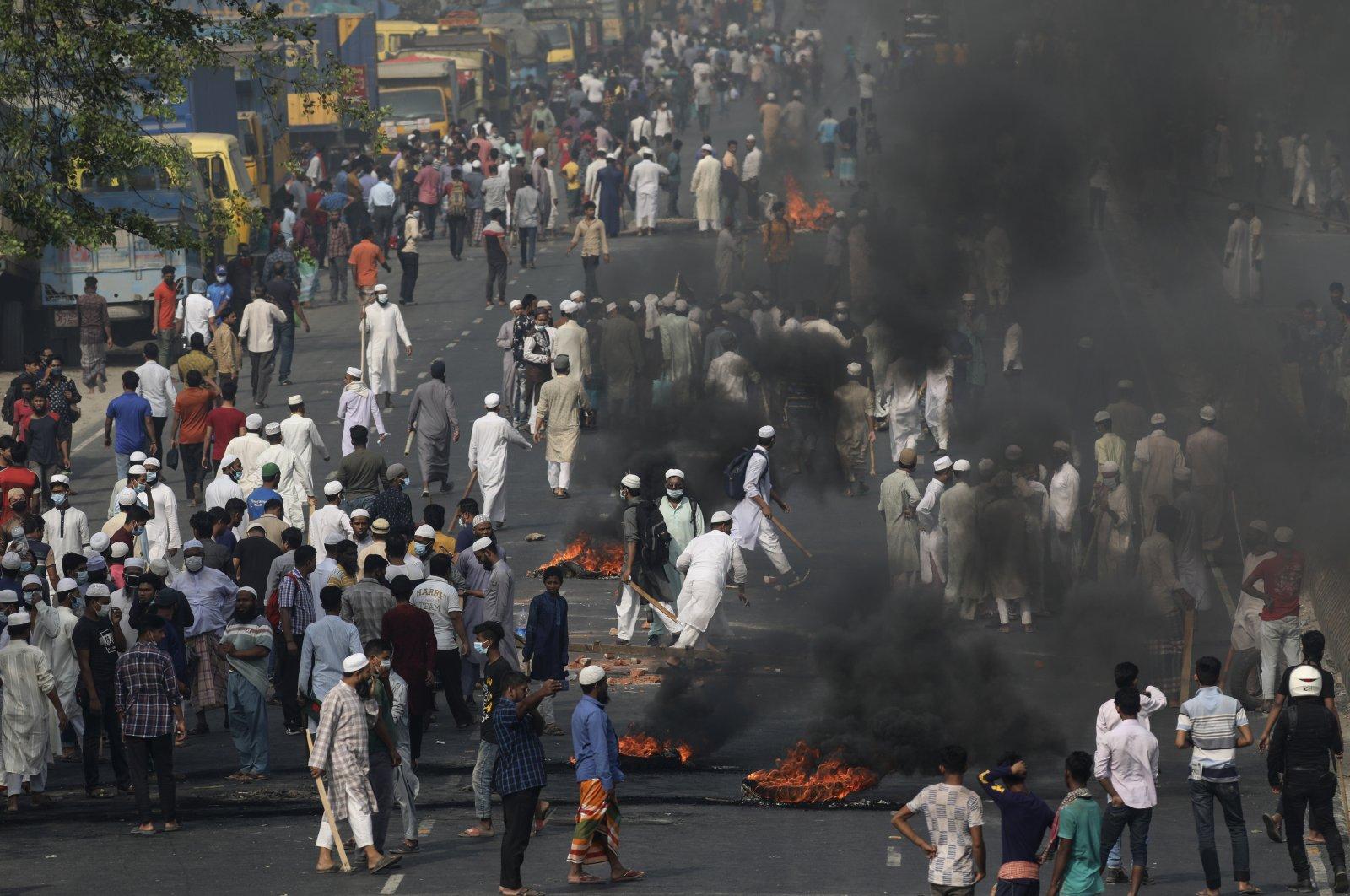 Activists of Bangladesh's Hefazat-e-Islam group burn tires to block traffic on the Dhaka Chittagong highway as they enforce a daylong general strike in Narayanganj, Bangladesh, March 28, 2021. (AP Photo)