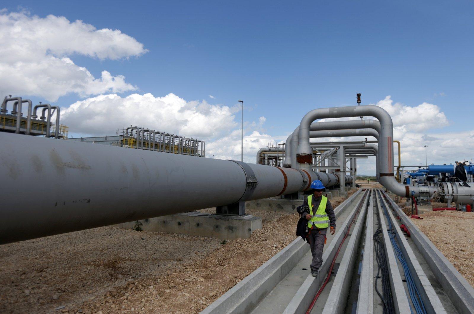 A local employee walks near a compressor station of the Trans Adriatic Pipeline (TAP) in Seman near Fier, Albania, April 11, 2019. (Reuters Photo)