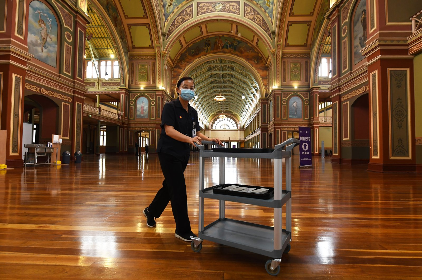 A health care worker transports COVID-19 vaccines inside the Royal Exhibition Building, Melbourne, Australia, March 22, 2021. (EPA Photo)
