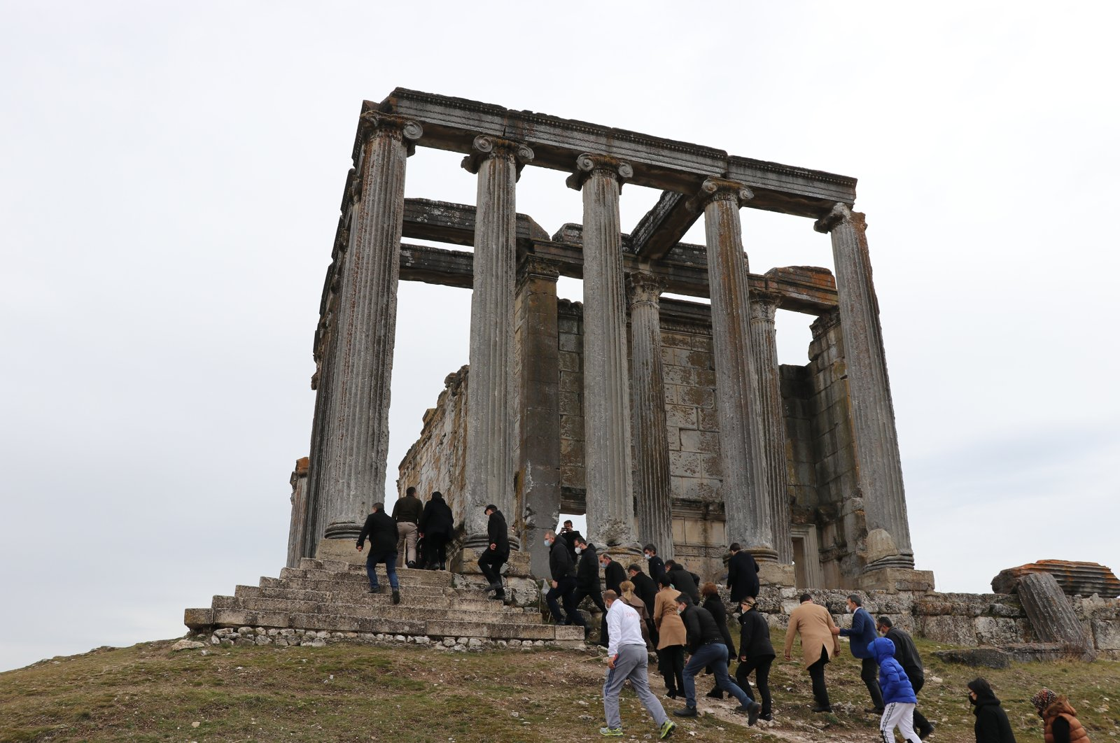 A group of people visit the ancient Temple of Zeus in the 5,000-year-old city of Aizanoi, Kütahya, western Turkey, March 14, 2021. (AA Photo)