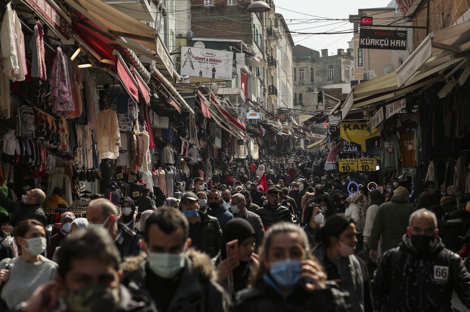 People walk in an open market in Istanbul, Monday, March 22, 2021. (AP Photo)