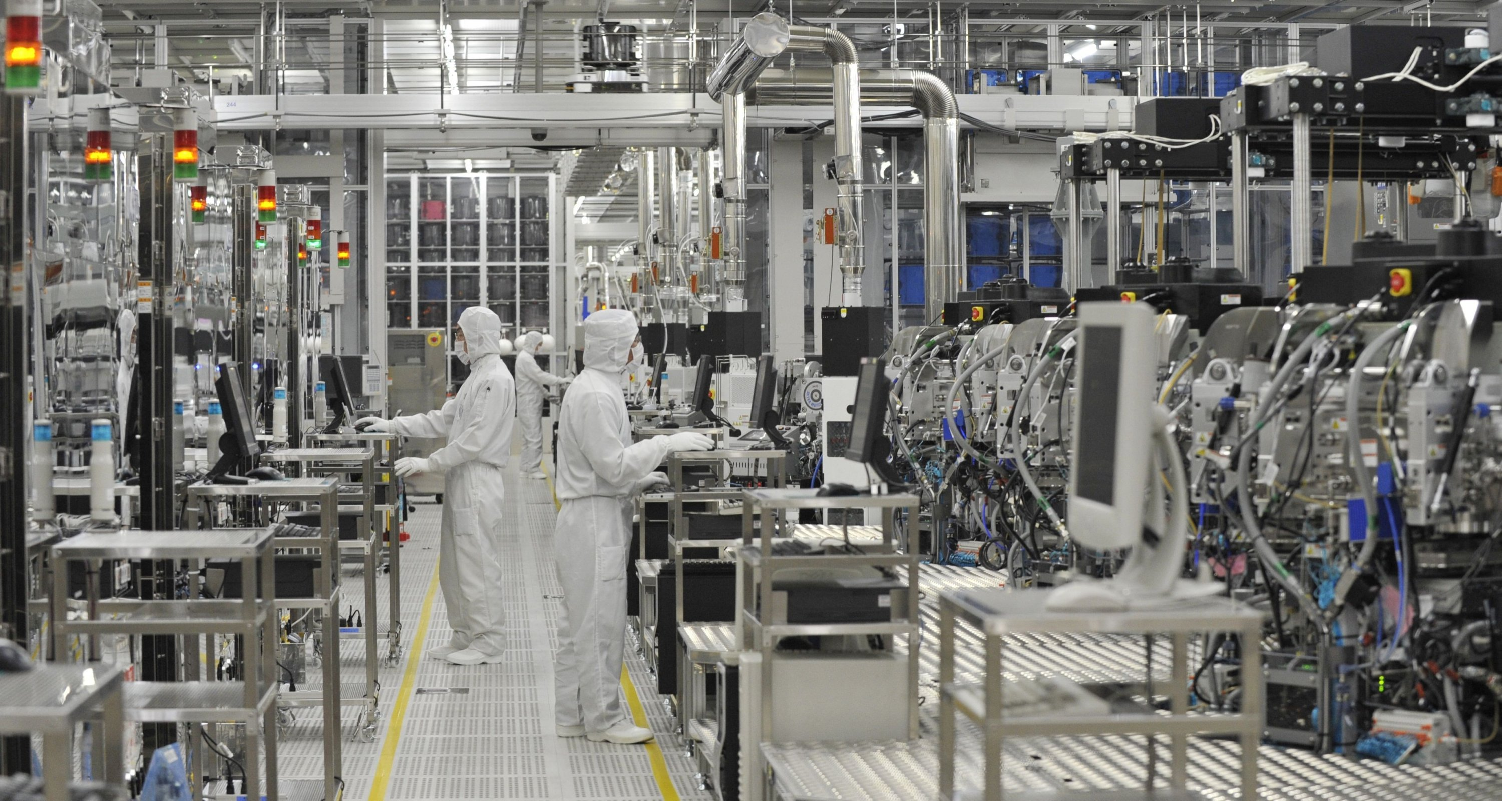 In this file photo employees of microprocessor maker Renesas Electronics work at the company's Naka wafer fabrication factory in Hitachinaka, Ibaraki prefecture, northeastern Japan, June 10, 2011.(AFP Photo)