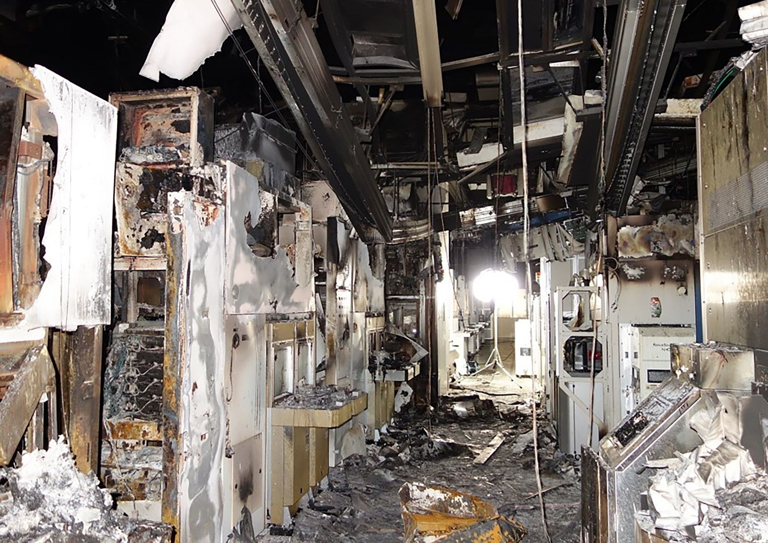 This undated handout photograph released on March 23, 2021 shows inside a company building after it was damaged in a fire in Hitachinaka, Ibaraki prefecture, northeastern Japan. (Jiji Press / Renesas Electronics via AFP)