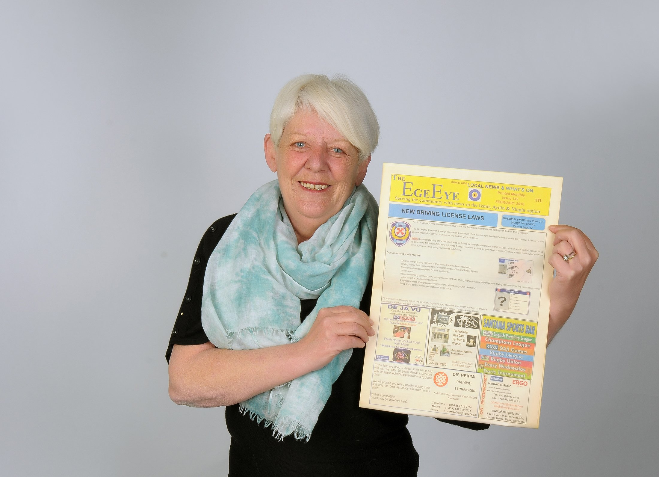 Lucille Shone, aka Lucy, holds the first edition of  The Ege Eye.