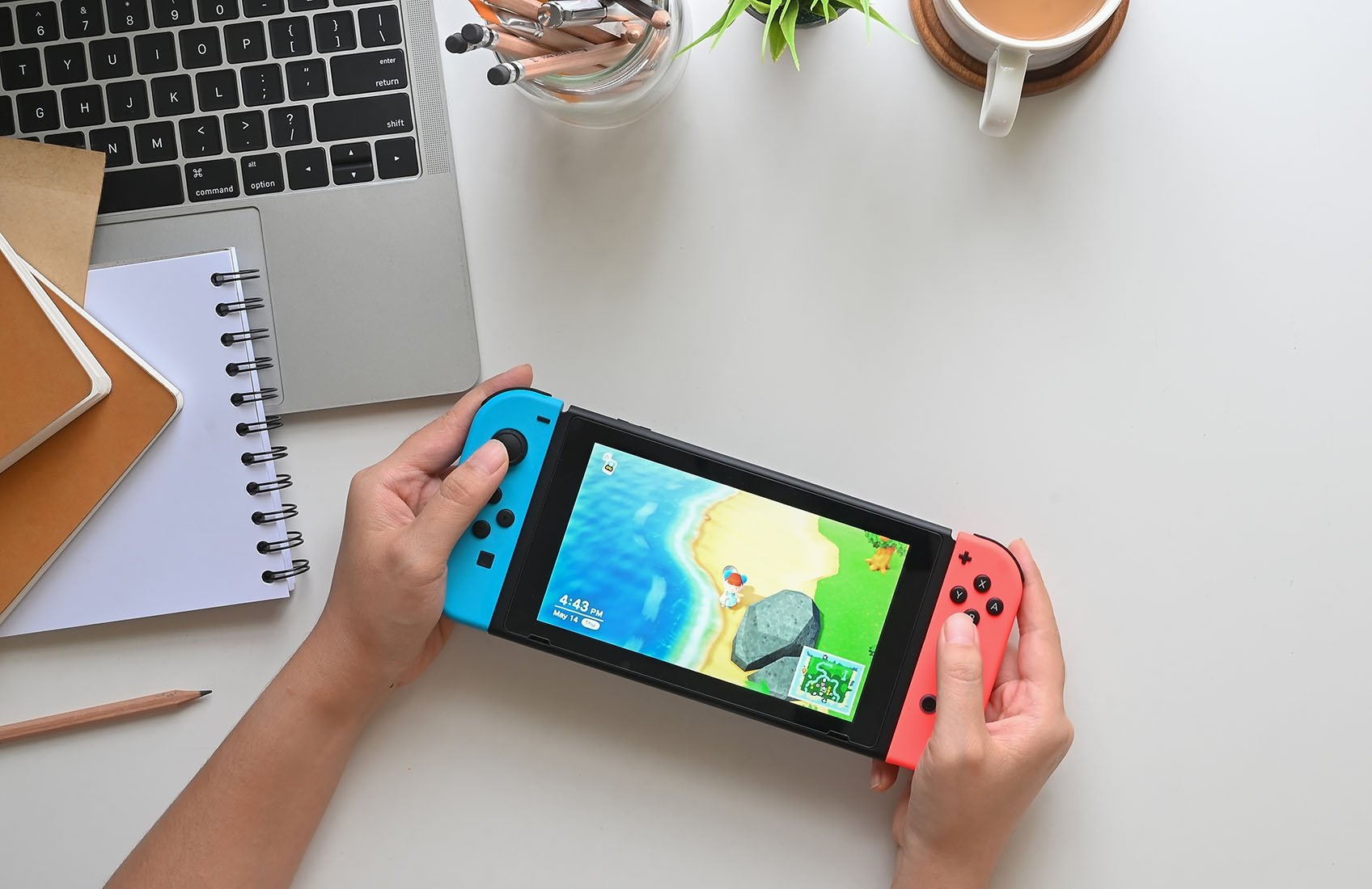 A woman plays Animal Crossing New Horizons on a Nintendo Switch console in Chiangmai, Thailand, May 14, 2020. (Shutterstock Photo)