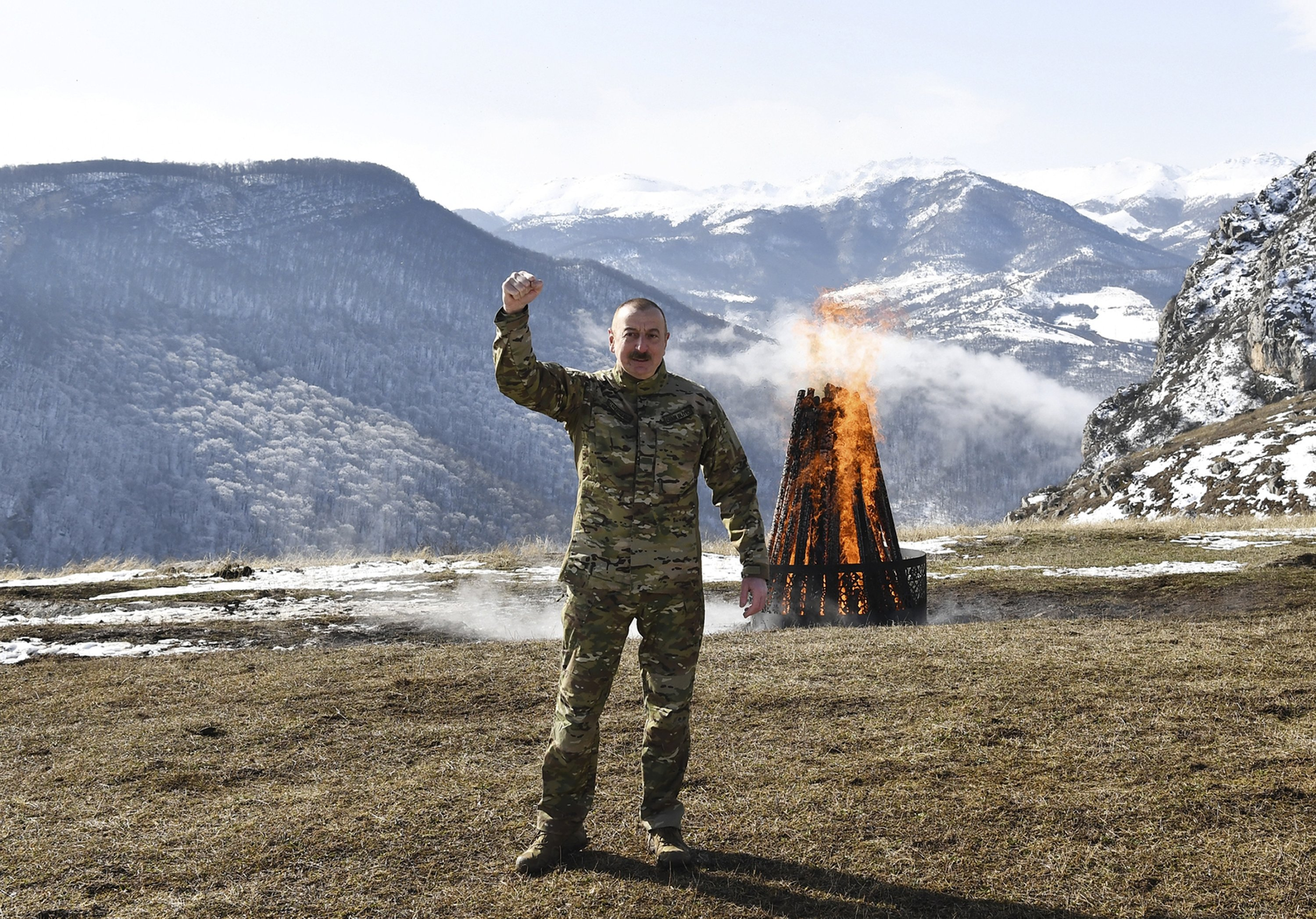 Azerbaijani President Ilham Aliyev gestures while celebrating Nevruz, a traditional holiday which celebrates the coming of Spring outside Shusha, Azerbaijan, March 20, 2021. (Photo by Getty Images)