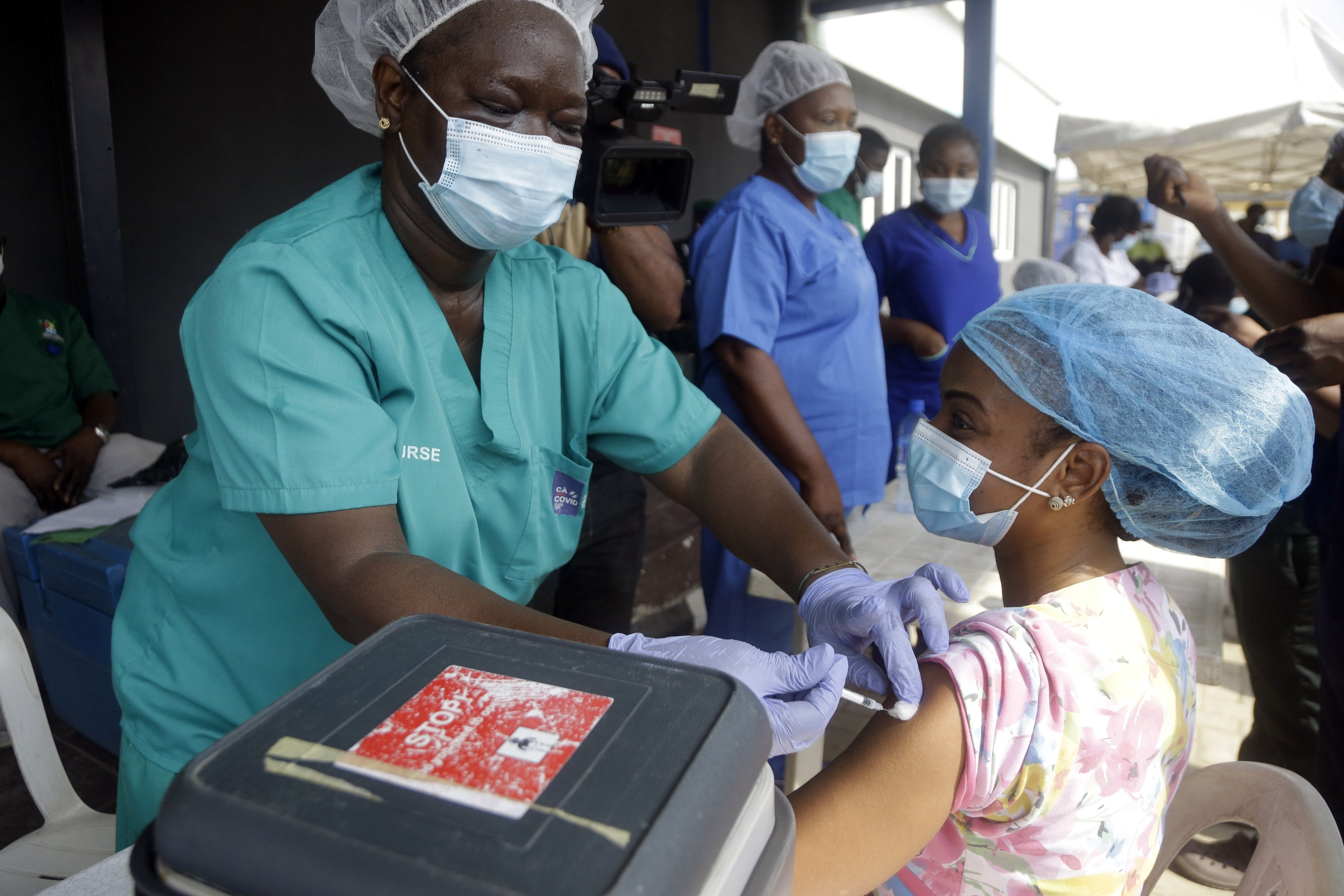 A hospital staff member receives one of the country's first coronavirus vaccinations, using the AstraZeneca vaccine provided through the global COVAX initiative, at Yaba Mainland hospital in Lagos, Nigeria, March 12, 2021. (AP Photo)