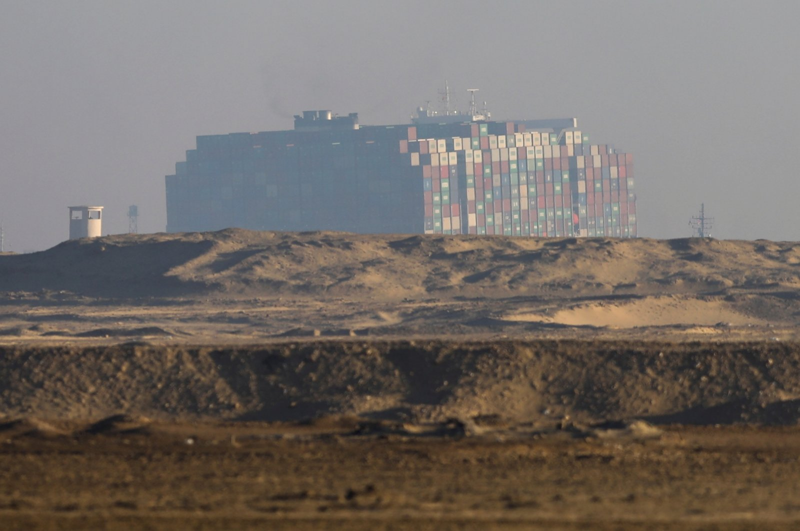 A view shows the refloated container ship Ever Given, one of the world's largest container ships, in Suez Canal, Egypt March 29, 2021. (Reuters Photo)