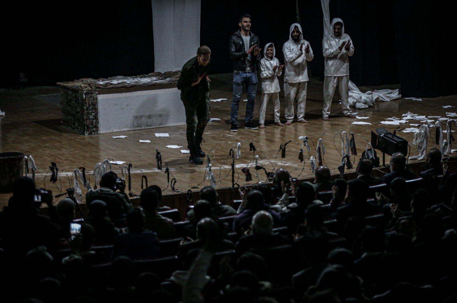 Syrian actors stage a play describing conditions in prisons of the Bashar Assad regime, Idlib, Syria, March 28, 2021. (AA Photo)