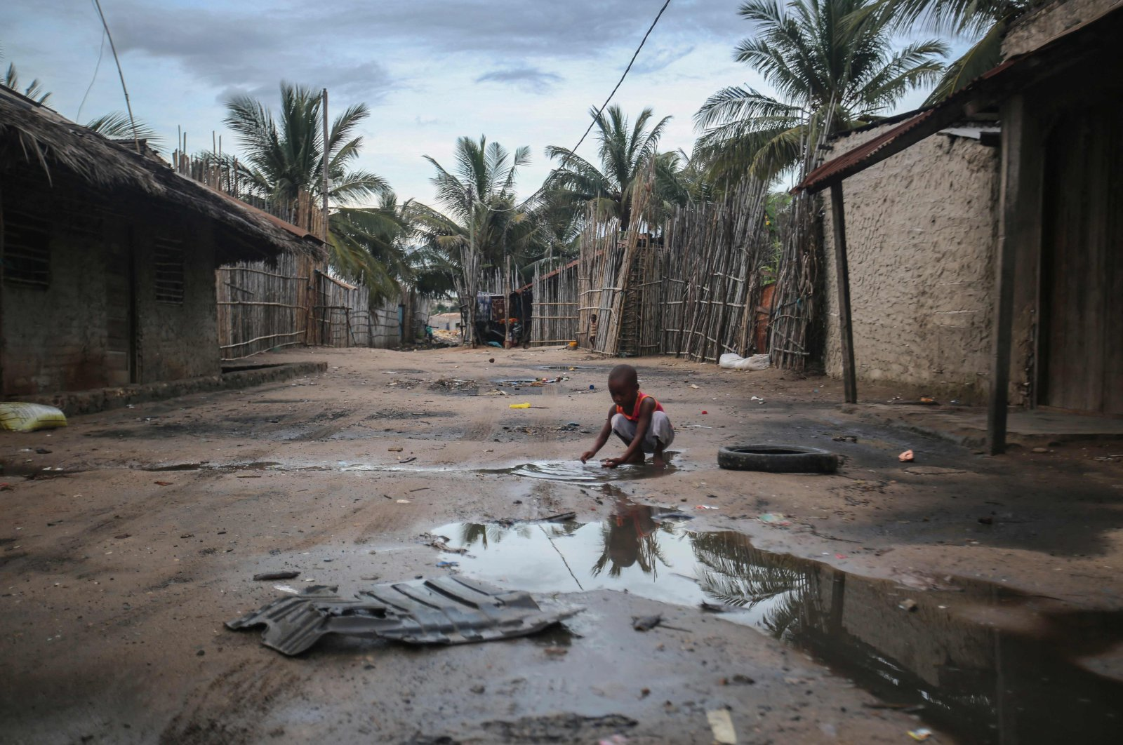 A child plays in one of the alleys of the port of Paquitequete near Pemba, Mozambique, March 29, 2021. (AFP Photo)