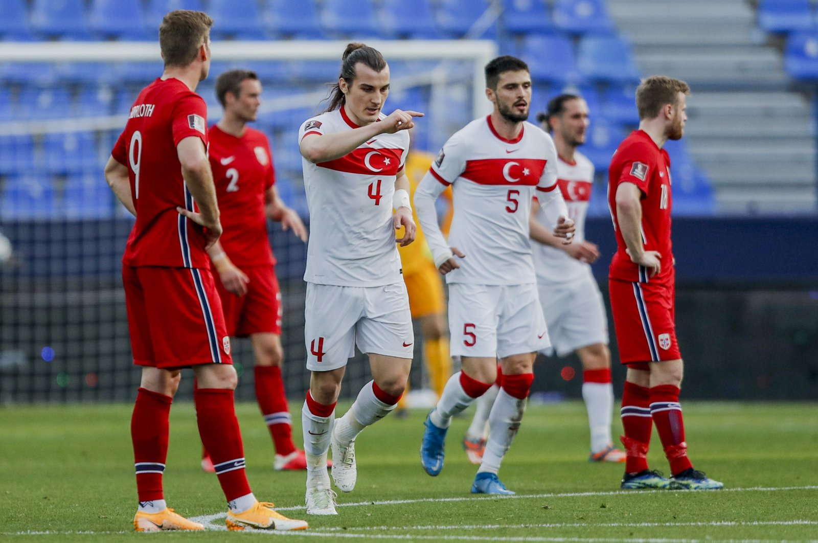 Turkish defender Çağlar Söyüncü (2nd R) celebrates after scoring his side's second goal in a World Cup 2022 Group G qualifier match against Norway at La Rosaleda stadium, Malaga, Spain, March 27, 2021. (AP Photo)