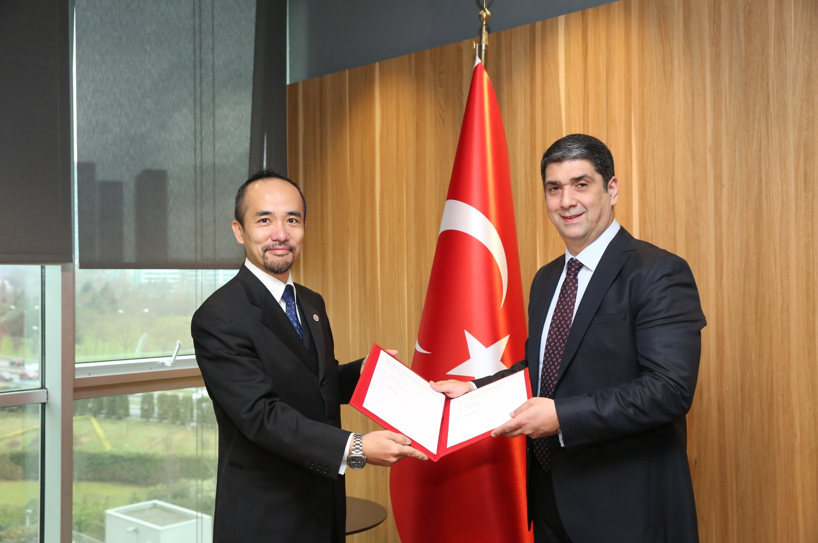 Turkey Development and Investment Bank (TKYB) General-Director Ibrahim Öztop (R) and Japan Bank for International Cooperation (JBIC) Istanbul Representative Ryuta Suzuki are seen in this photo provided on March 29, 2021. (Courtesy of TKYB)