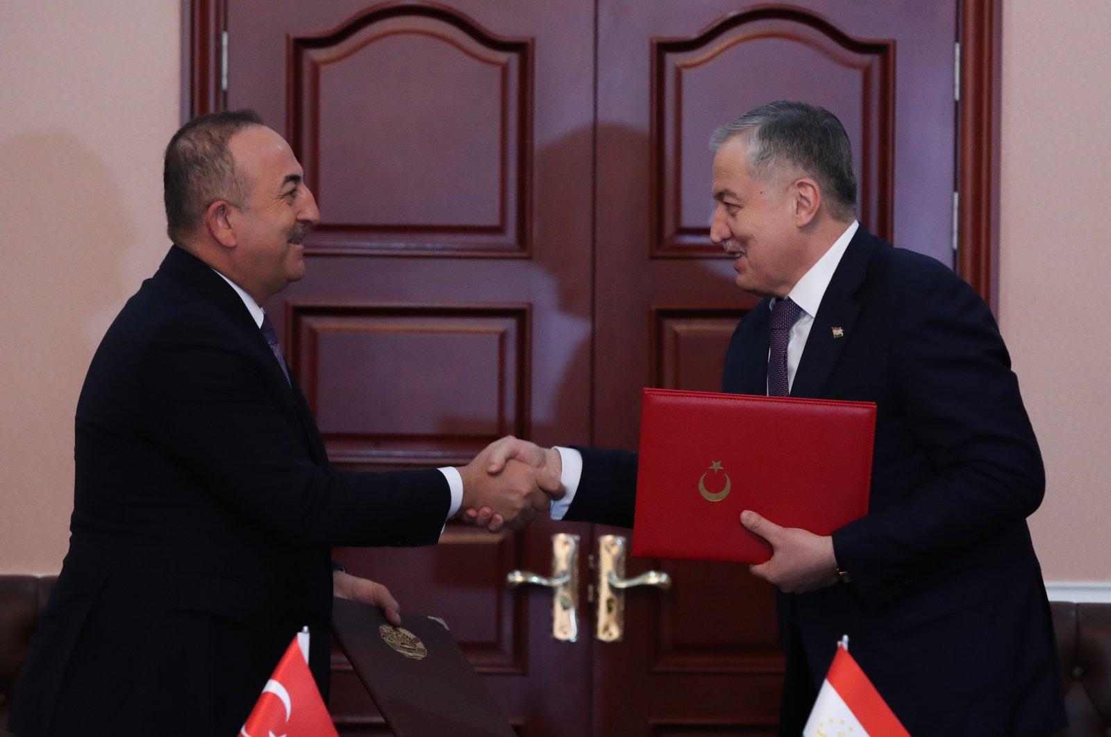 Turkey's Foreign Minister Mevlüt Çavuşoğlu (L) meets with Tajikistan's foreign minister, Sirojiddin Muhriddin, in Dushanbe, the capital of Tajikistan, March 29, 2021. (AA Photos)