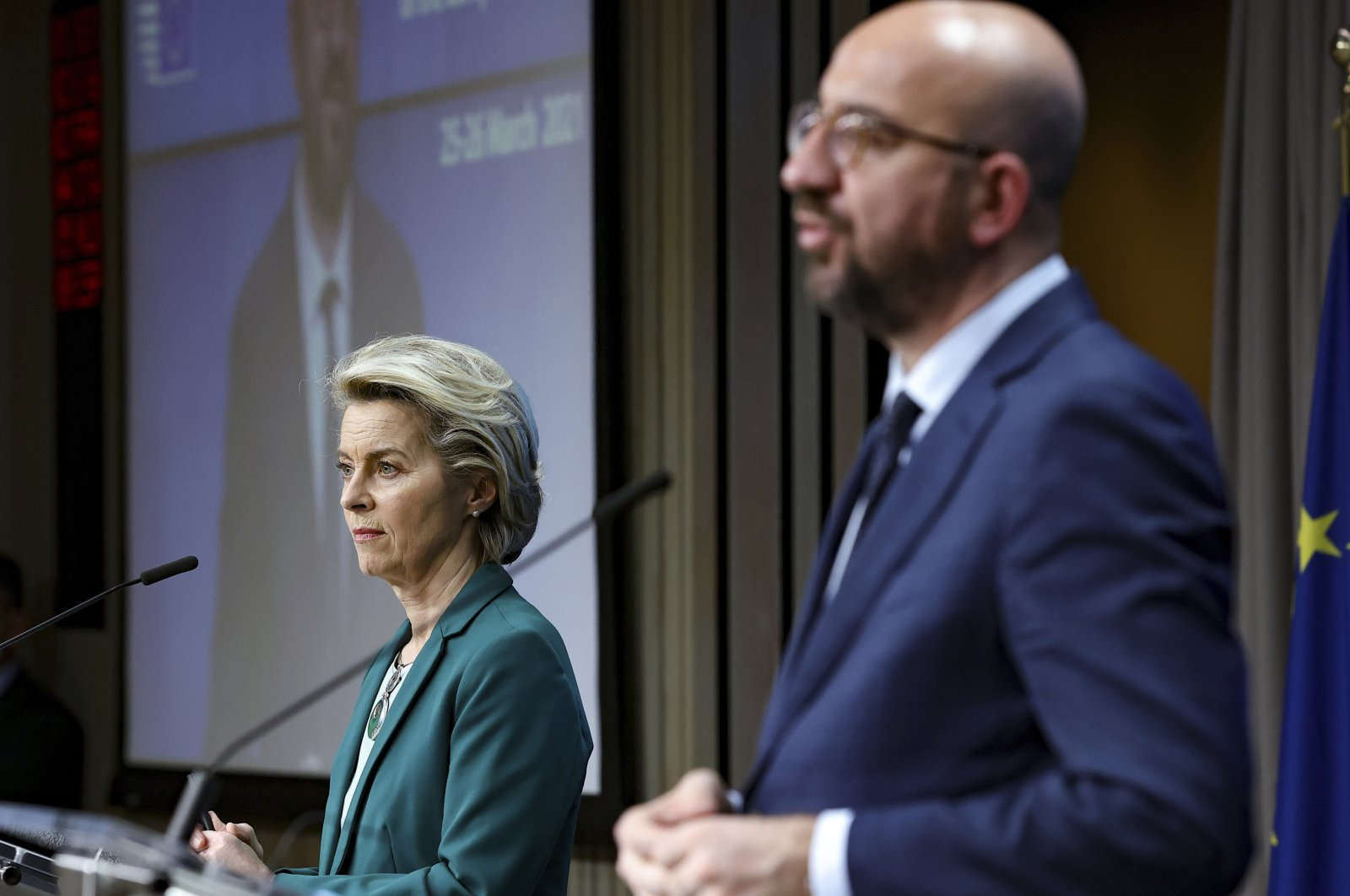 European Commission President Ursula von der Leyen (L), listens to European Council President Charles Michel during an online news conference at the end of an EU summit at the European Council building in Brussels, March 25, 2021. (AP Photo)