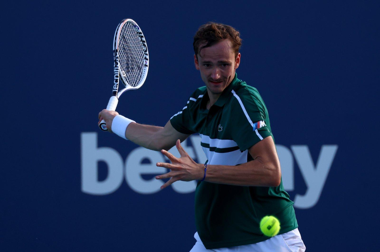Russia's Daniil Medvedev returns a shot against Australia's Alexei Popyrin during a Miami Open men's singles third-round match in Miami Gardens, Florida, U.S., March 28, 2021. (AFP Photo)