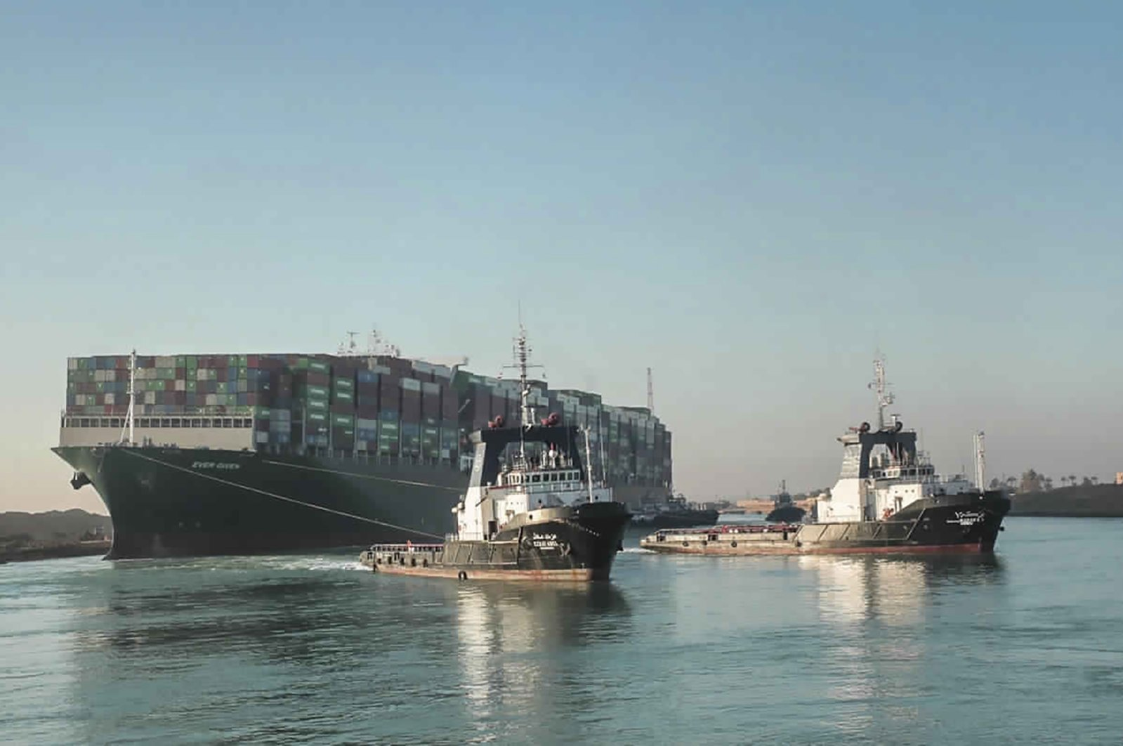 The Ever Given, a Panama-flagged cargo ship, is pulled by tugboats, in the Suez Canal, Egypt, March 29, 2021. (Suez Canal Authority via AP)