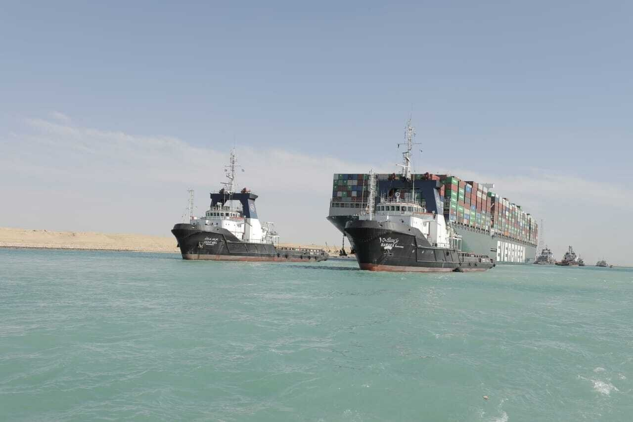The Ever Given, a Panama-flagged cargo ship is accompanied by Suez Canal tugboats as it moves in the Suez Canal, Egypt, March 29, 2021. (Suez Canal Authority via AP)