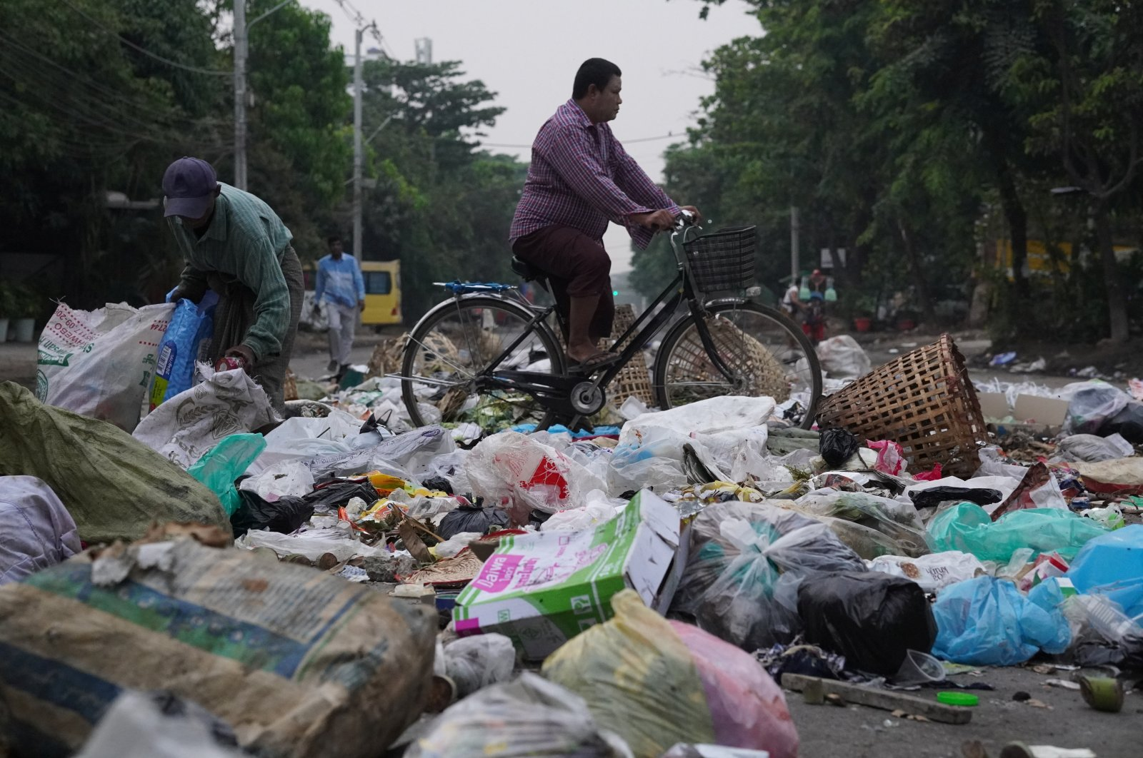 Residents use trash to block streets as a form of protest in Thaketa township, Yangon, Myanmar, in this image obtained by Reuters on March 30, 2021. (Reuters Photo)