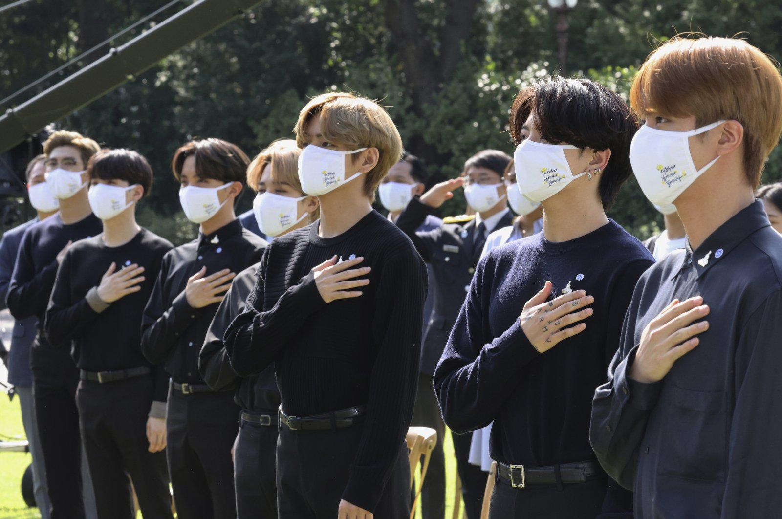 South Korean K-pop group BTS salutes their national flag during a ceremony marking the National Youth Day at the presidential Blue House in Seoul, South Korea, Sept. 19, 2020. (AP Photo)