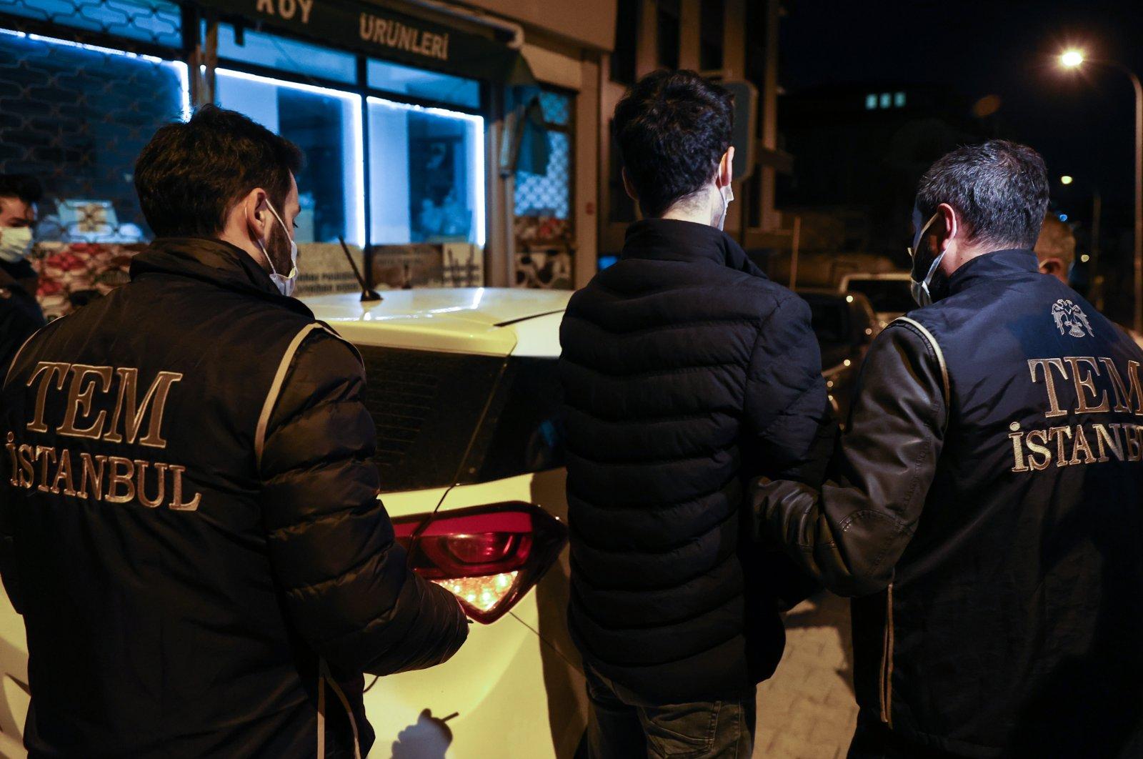 Police escort a suspect captured in Istanbul, Turkey, Mar. 30, 2021. (AA PHOTO)