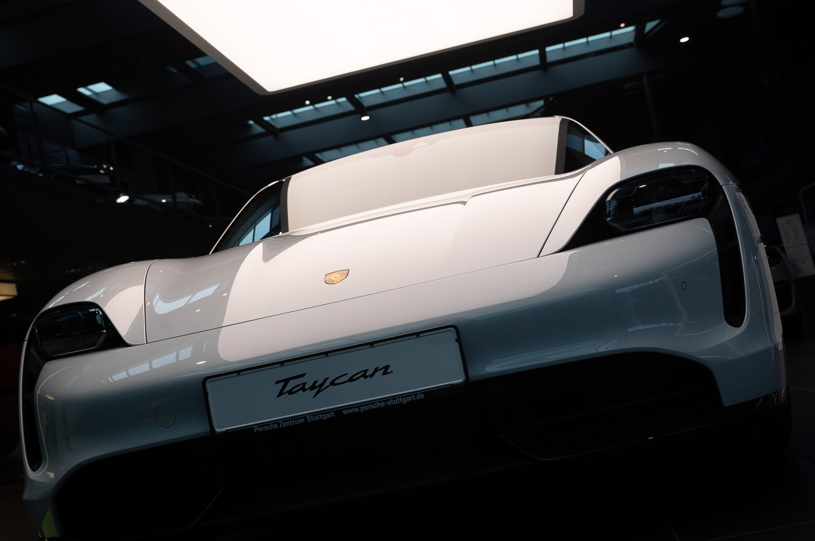 An electric Porsche Taycan Turbo S stands in the Porsche centre, Stuttgart, Germany, March 16, 2021. ( Getty Images )
