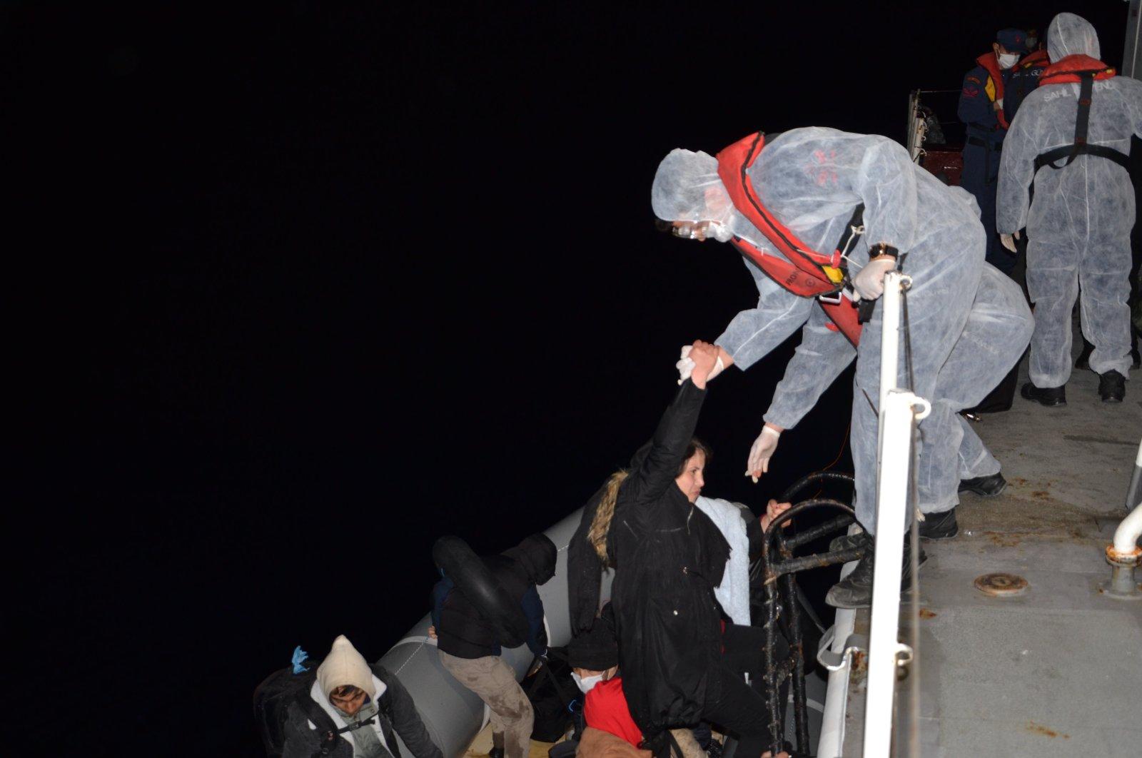 Turkish Coast Guard rescues irregular migrants pushed into Turkish territorial waters by Greek coast guard, Izmir, Turkey, March 29, 2021. (IHA Photo)