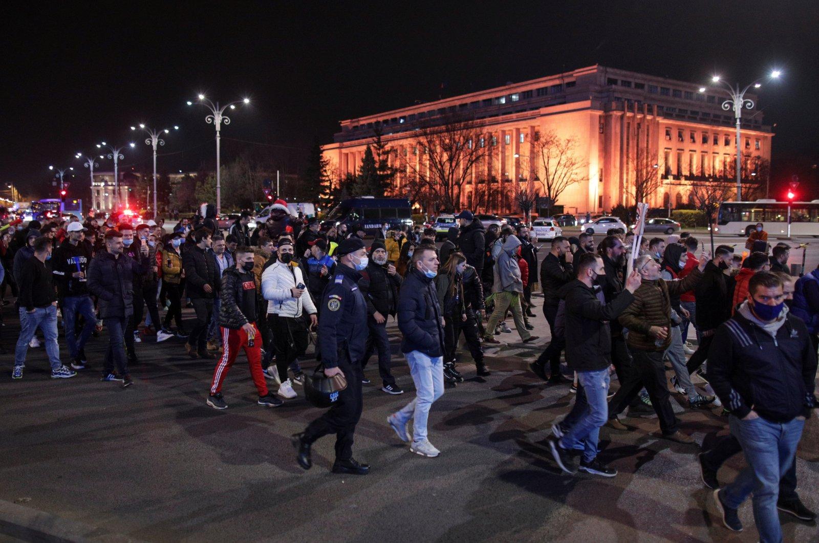 People march demanding an end to coronavirus restrictions, in Bucharest, Romania, March 30, 2021. (Inquam Photos / Octav Ganea via Reuters)