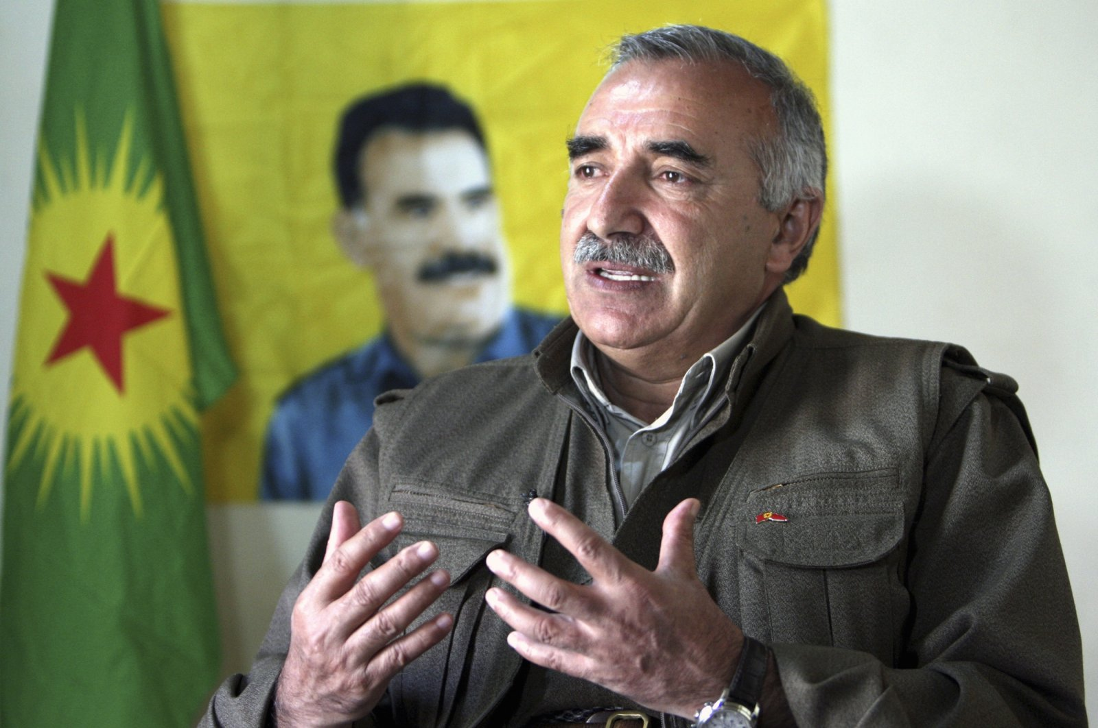 Murat Karayılan, acting leader of the PKK terrorist group, speaks during an interview with Reuters in the Qandil mountains near the Iraq-Turkish border, 330 kilometers (205 miles) northeast of Baghdad in Sulaymaniyah, Iraq, March 24, 2013. (Reuters Photo)