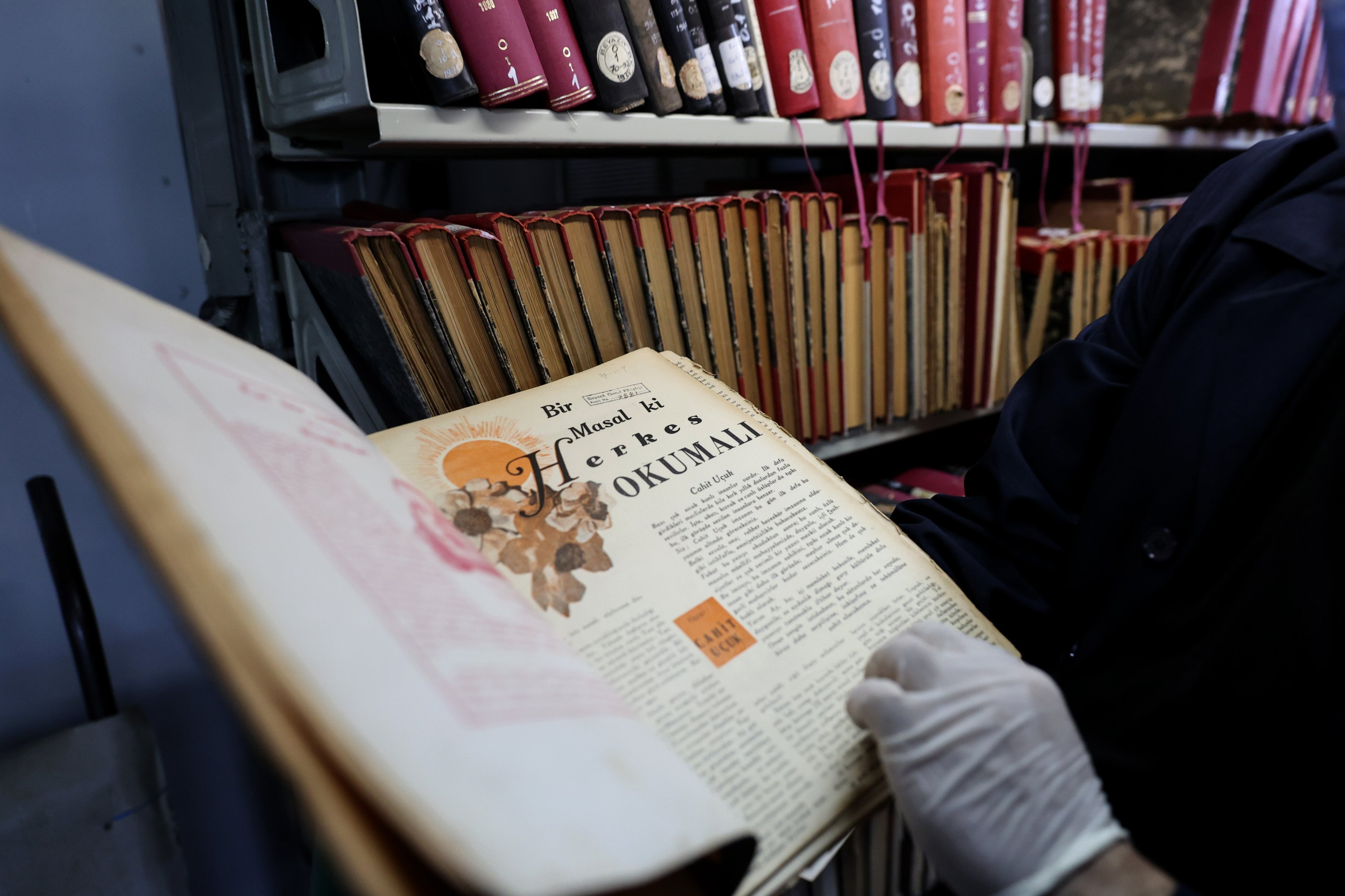 An official shows a book from the archive of Beyazıt State Library, Istanbul, Turkey, March 28, 2020. (AA Photo)
