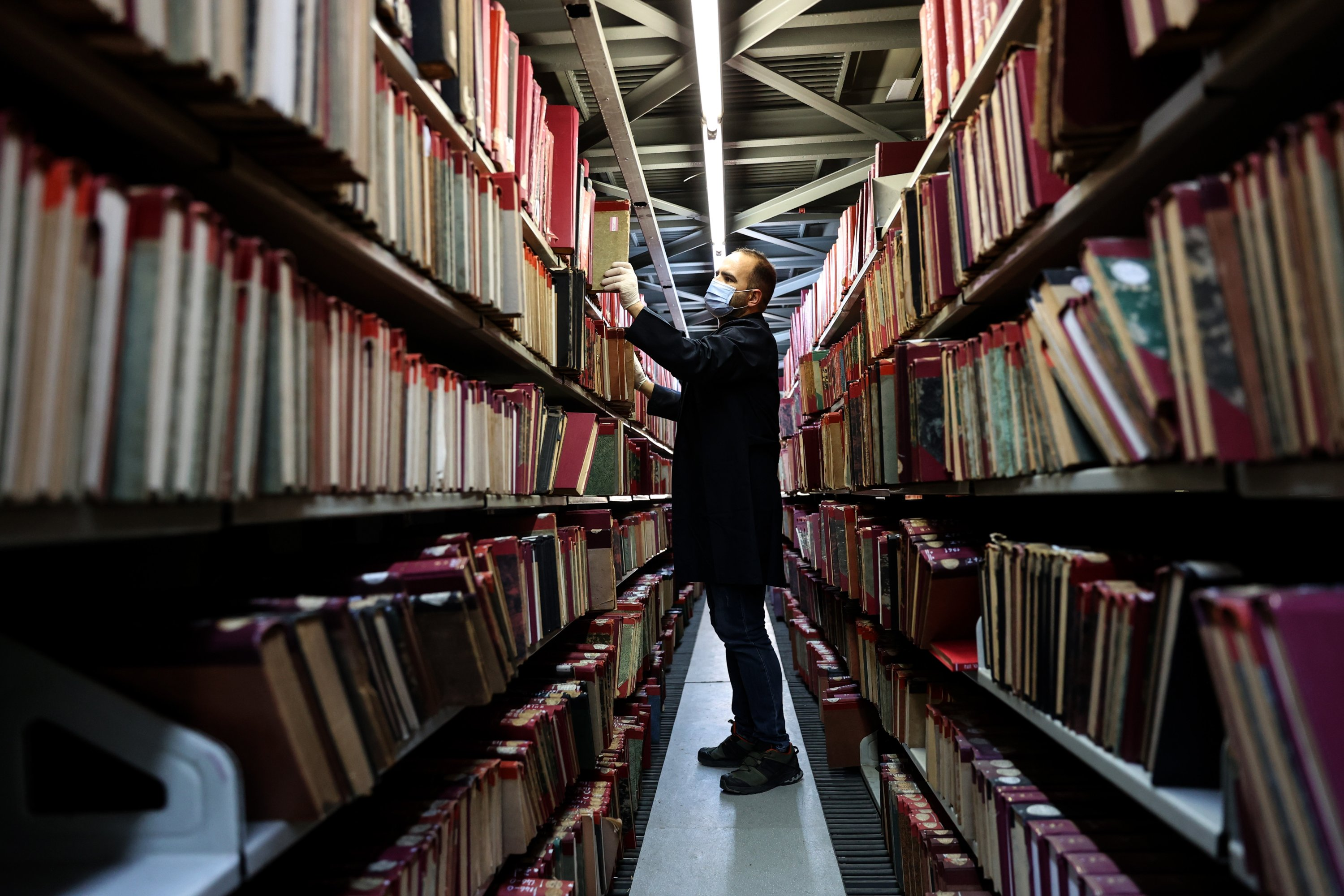 An official is seen among the books of Beyazıt State Library, Istanbul, Turkey, March 28, 2020. (AA Photo)