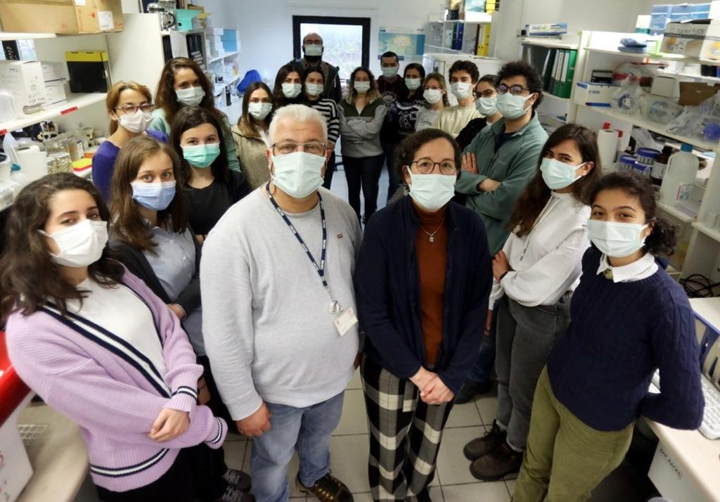 Mayda and Ihsan Gürsel (front R and L) pose with fellow researchers at a hospital where trials began in the capital Ankara, Turkey, March 27, 2021. (AA PHOTO)