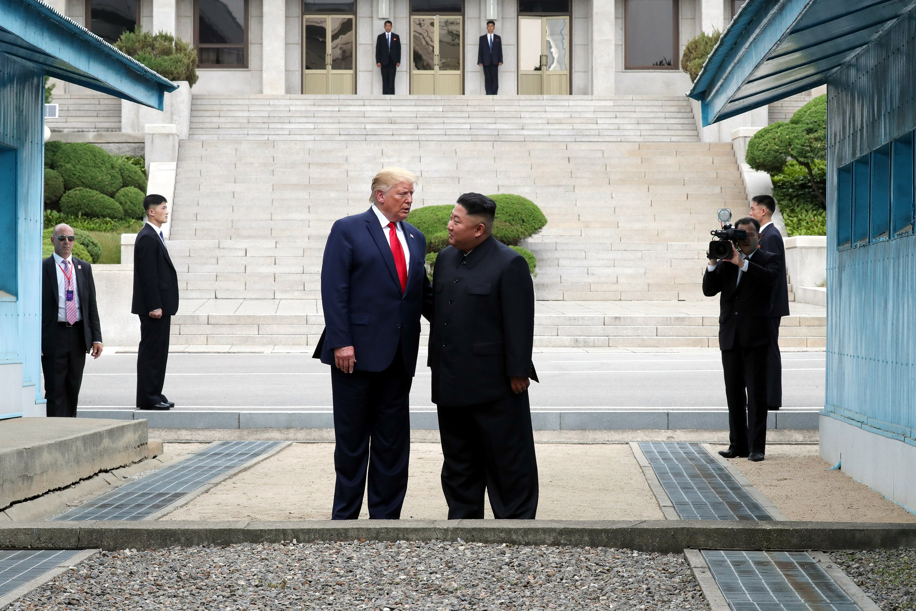 U.S. President Donald Trump and North Korean leader Kim Jong Un stand inside the demilitarized zone (DMZ) separating North and South Korea, in Panmunjom, South Korea, June 30, 2019. (Photo by Getty Images)