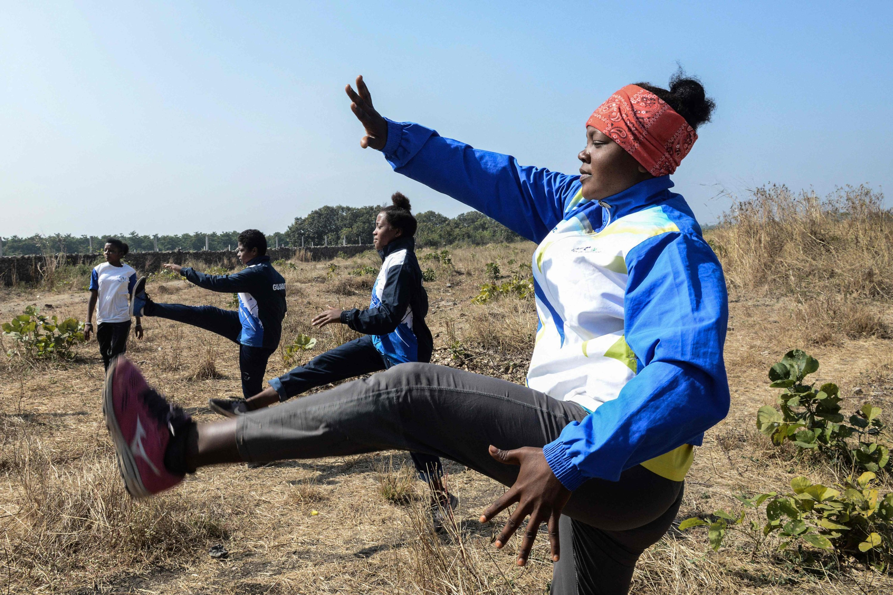 Shenaz Lobi (R), along with other members of the Siddi community, taking part in an exercise routine during an athletes program at Jambur village, in Junagadh district of Gujarat, India, Jan. 6, 2021.