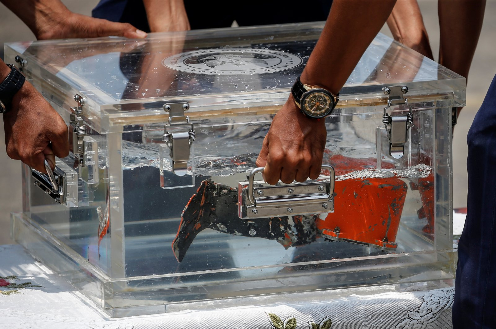 National Transportation Safety Committee (KNKT) officials place the cockpit voice recorder (CVR) of Sriwijaya Air flight SJ 182 on a table at Tanjung Priok Port in Jakarta, Indonesia, March 31, 2021. (Reuters Photo)