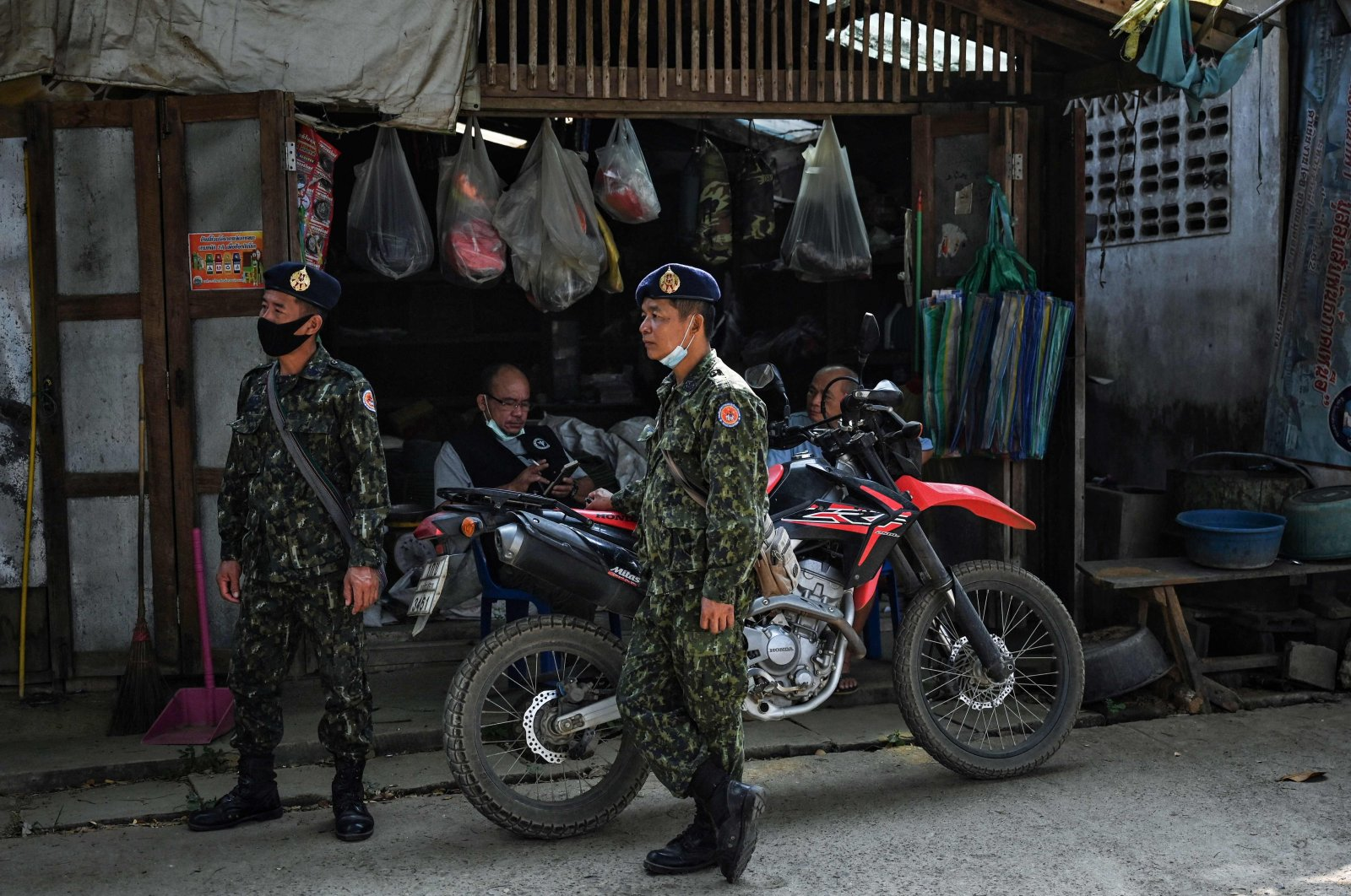 Thai soldiers stand outside a shop in Mae Sam Laep town in Mae Hong Son province, Thailand, March 31, 2021. (AFP Photo)