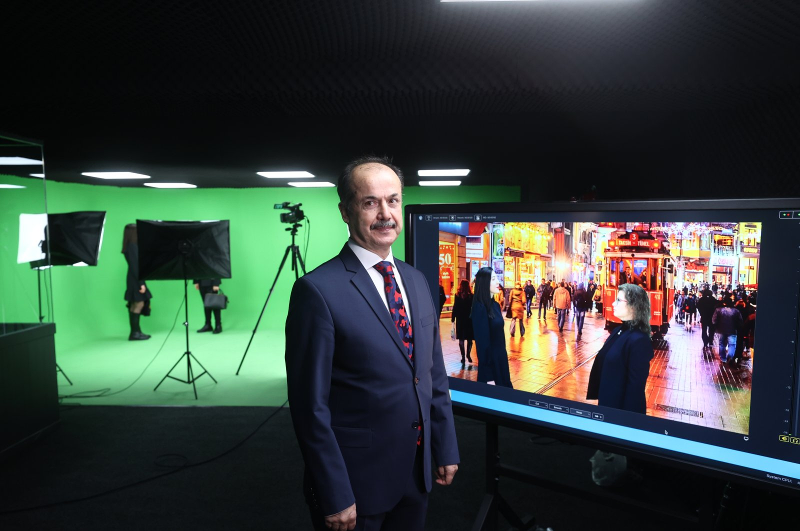 YEE head Şeref Ateş poses in front of a screen showing a Turkish language teaching video in the capital Ankara, Turkey, March 30, 2021. (AA Photo)