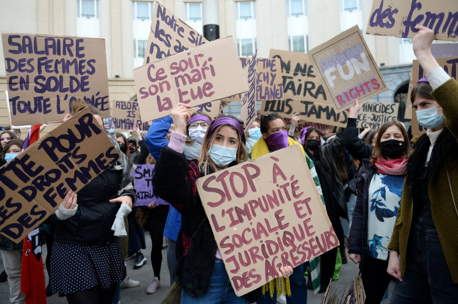 Women hold placards during a demonstration to call for gender equality and demanding an end to violence against women to mark International Women's Day in Brussels, Belgium, March 8, 2021. (Reuters Photo)