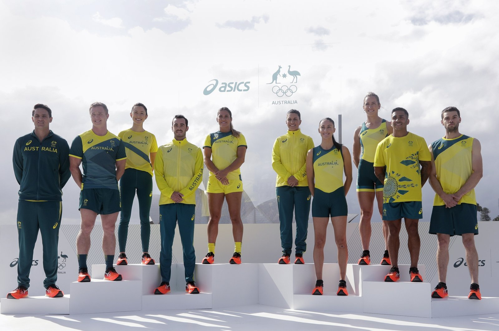 Olympic hopefuls pose for photos in their green and gold competition kits in Sydney, Australia, March 31, 2021. (AP Photo)